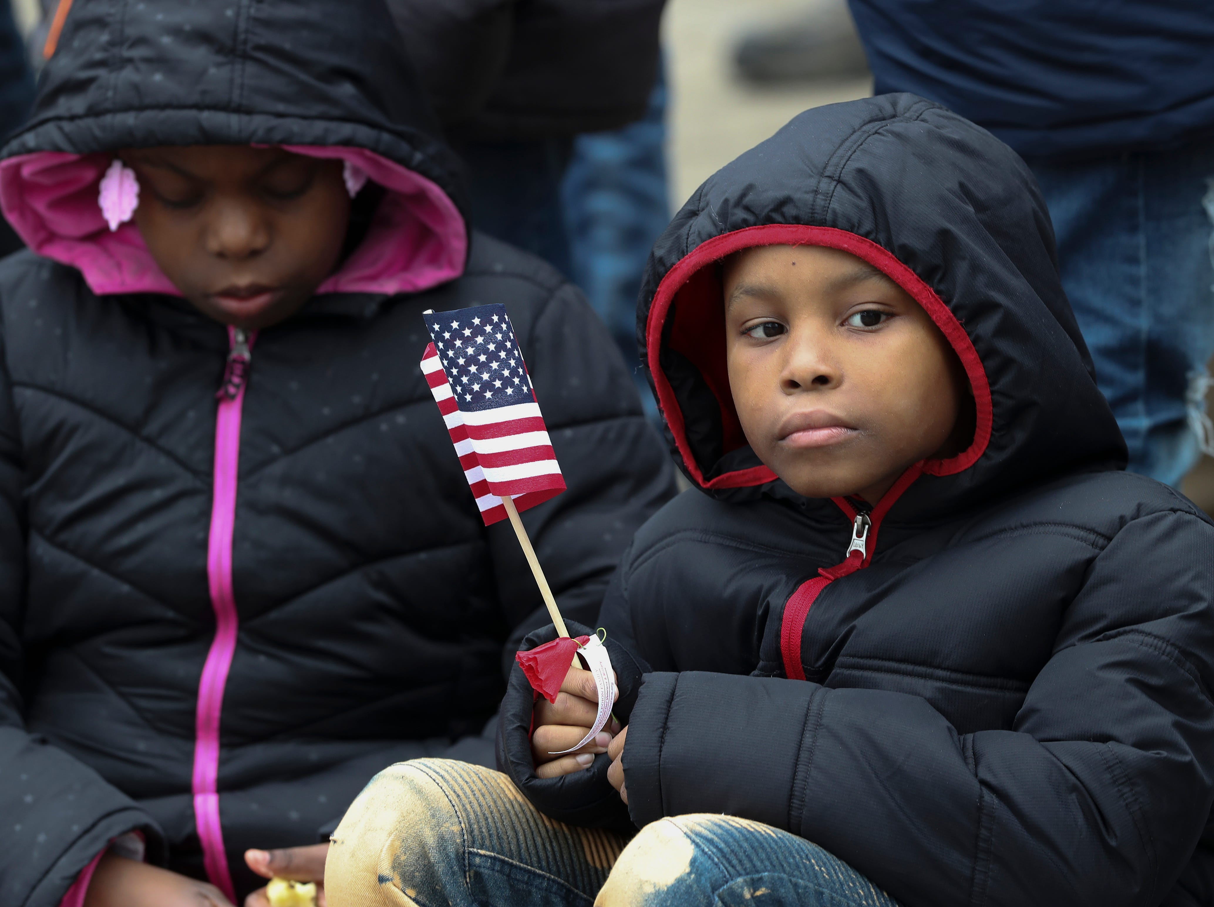 TySean Murrell, 9, watched the Veterans Day Parade march down Jefferson Street.Nov. 9, 2018