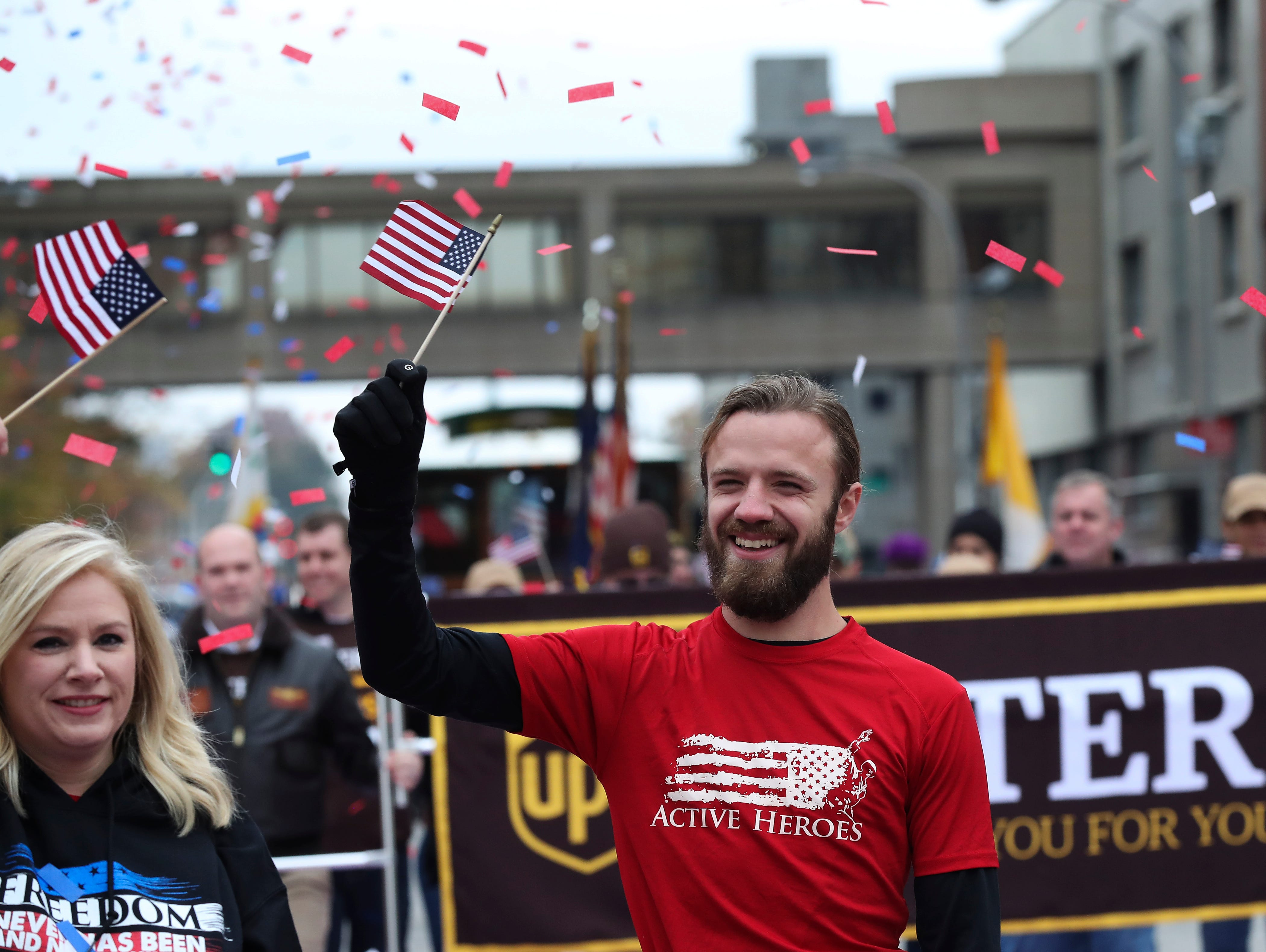Jeremy Sneed, of Active Heroes, marched down Jefferson Street during the Veterans Day Parade.  Active Heroes highlights military suicide and prevention.Nov. 9, 2018