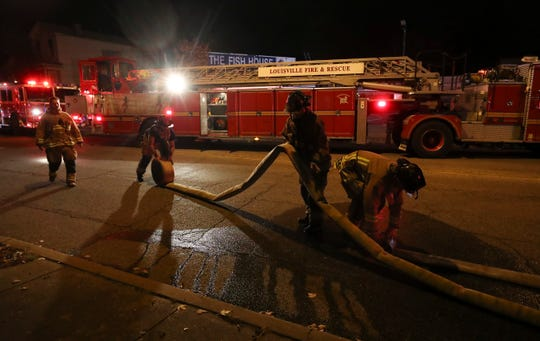 Firefighters finish working the scene a blaze at the Fish House on Winter Avenue.   Nov. 8, 2018