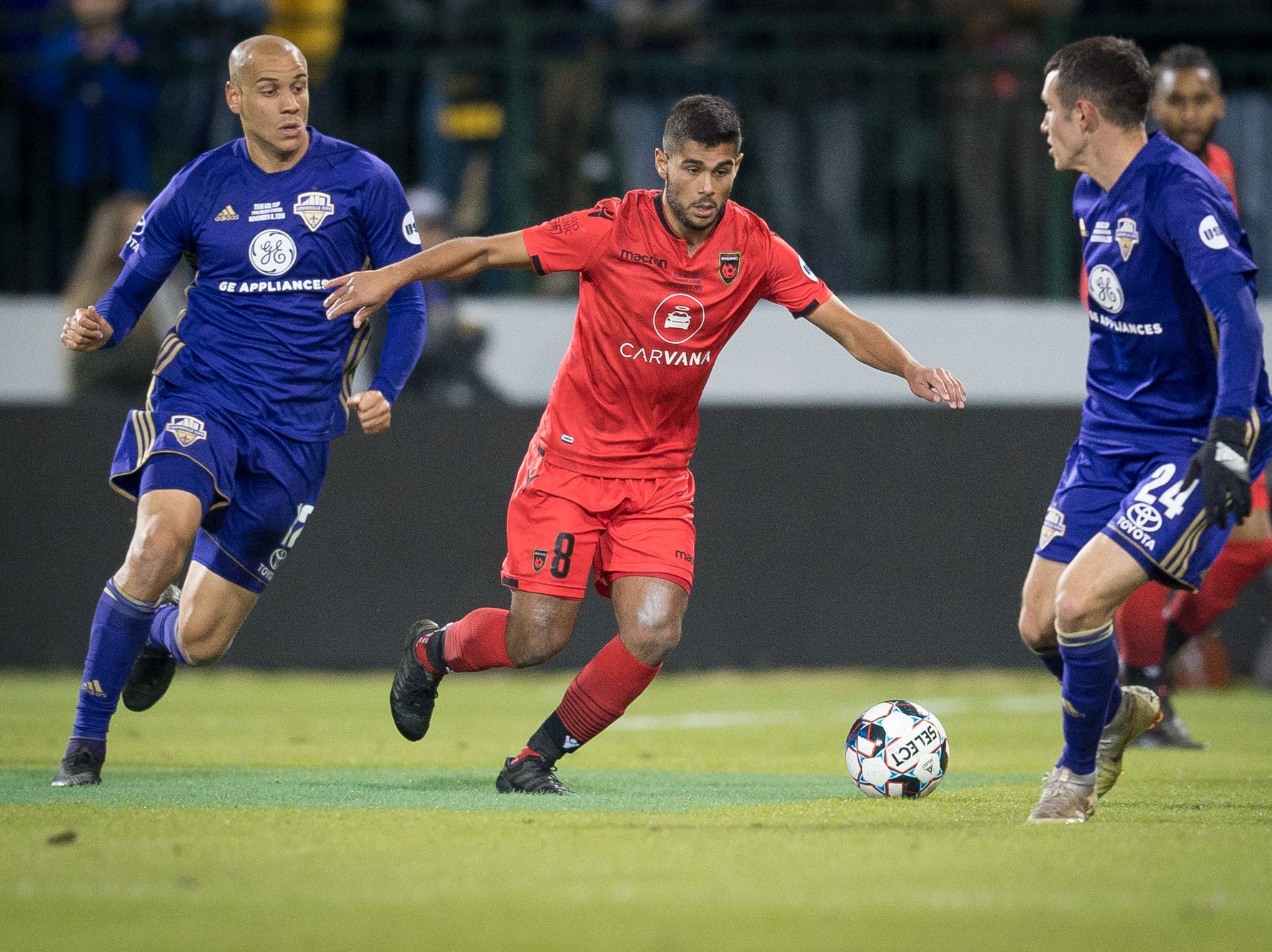 Phoenix Rising FC midfielder Collin Fernandez (8) is trapped between Louisville City FC midfielder Kyle Smith (24) and forward Luke Spencer (12) during the USL Cup final played at Lynn Stadium on the campus of the University of Louisville, Louisville, Ky., Thursday, Nov., 8, 2018. (PHOTO Bryan Woolston)