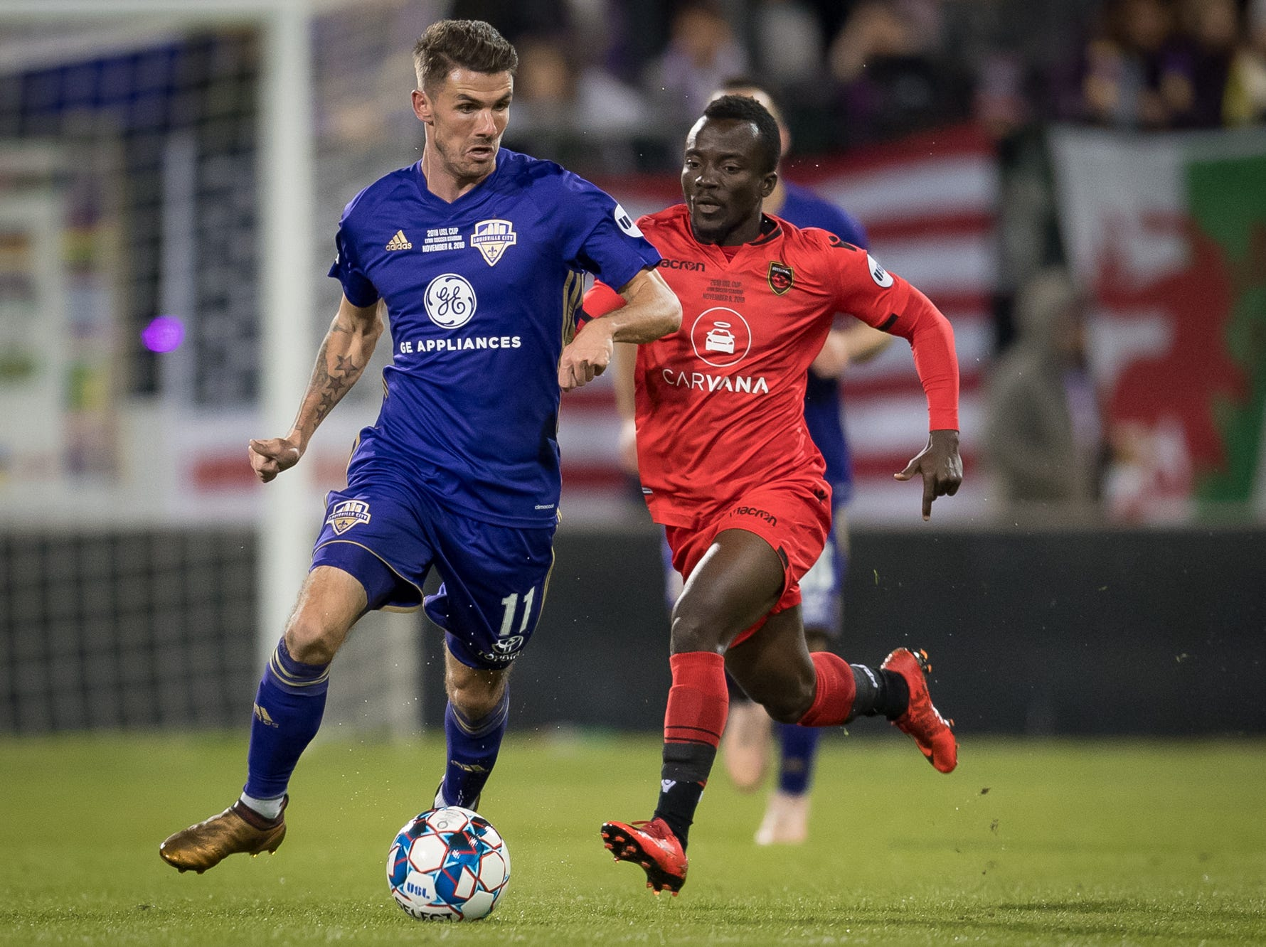 Louisville City FC midfielder Niall McCabe (11) plays against Phoenix Rising FC forward Solomon Asante (20) during the USL Cup final played at Lynn Stadium on the campus of the University of Louisville, Louisville, Ky., Thursday, Nov., 8, 2018. (PHOTO Bryan Woolston)