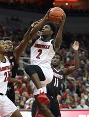 Louisville's Darius Perry (2) blew past a couple of Nicholls State defenders during their game at the Yum Center.   Nov. 8, 2018