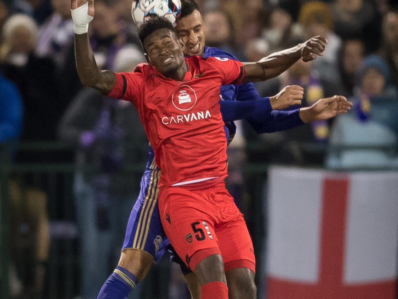 Louisville City FC defender Paco Craig (5) collides with Phoenix Rising FC forward Kevaughn Frater (51) during the USL Cup final played at Lynn Stadium on the campus of the University of Louisville, Louisville, Ky., Thursday, Nov., 8, 2018.