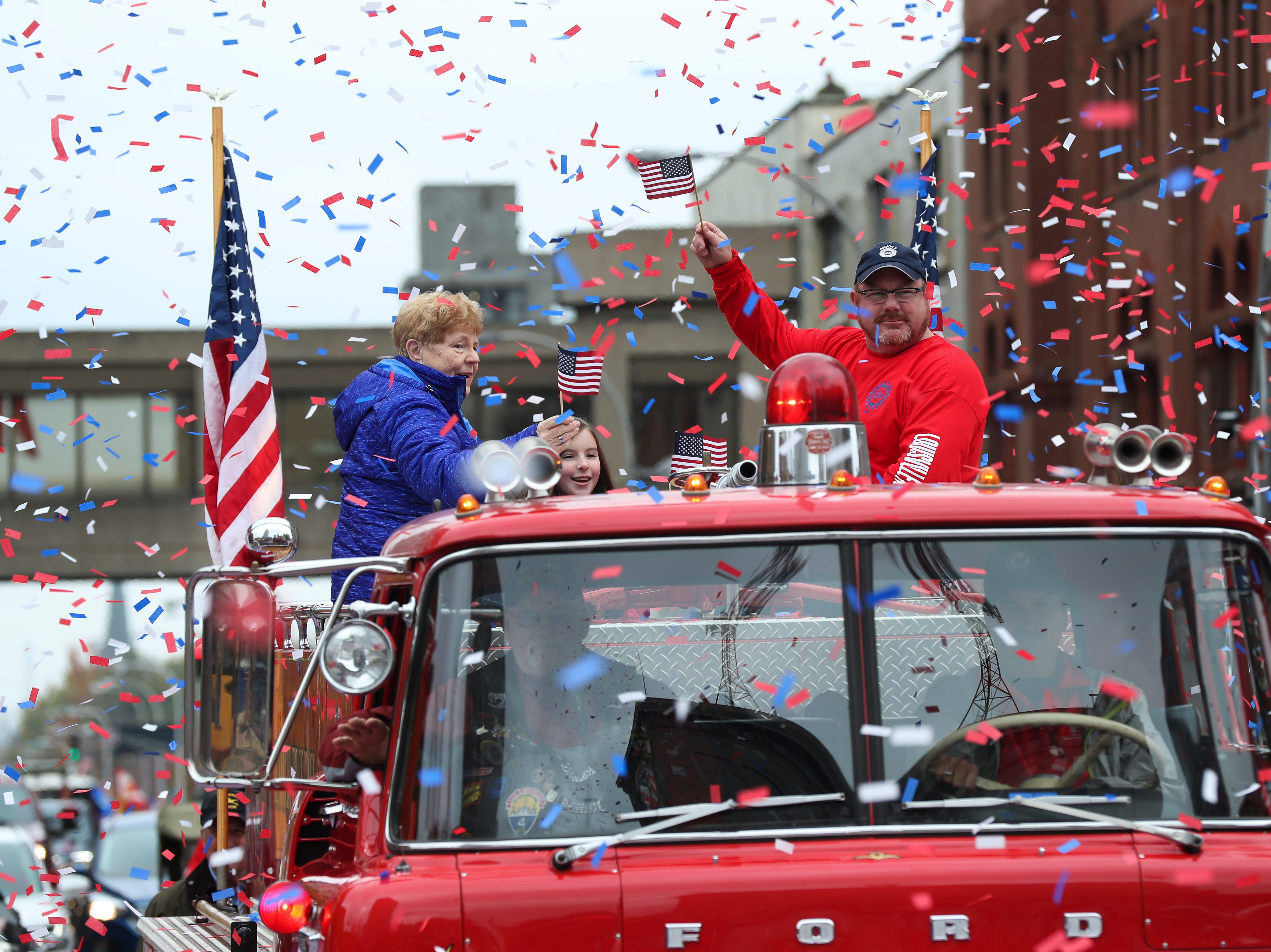 Participants were covered in confetti as they made their way down Jefferson Street during the Veterans Day Parade.  Nov. 9, 2018