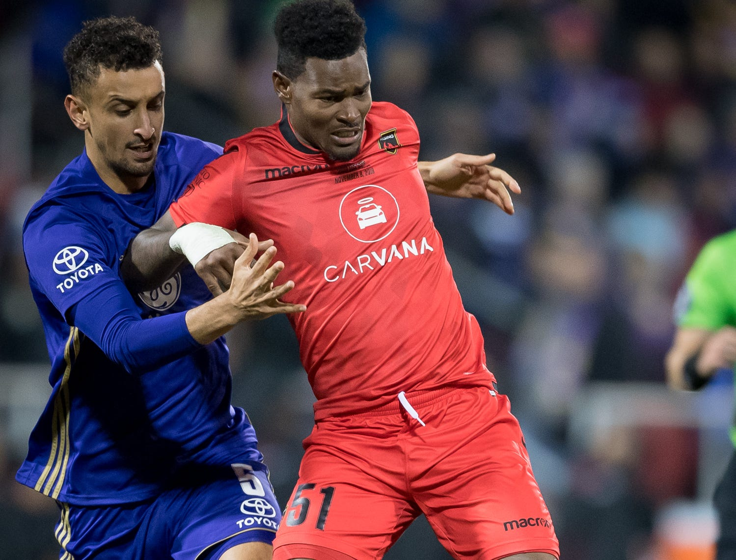 Louisville City FC defender Paco Craig (5) collides with Phoenix Rising FC forward Kevaughn Frater (51) during the USL Cup final played at Lynn Stadium on the campus of the University of Louisville, Louisville, Ky., Thursday, Nov., 8, 2018. (PHOTO Bryan Woolston)