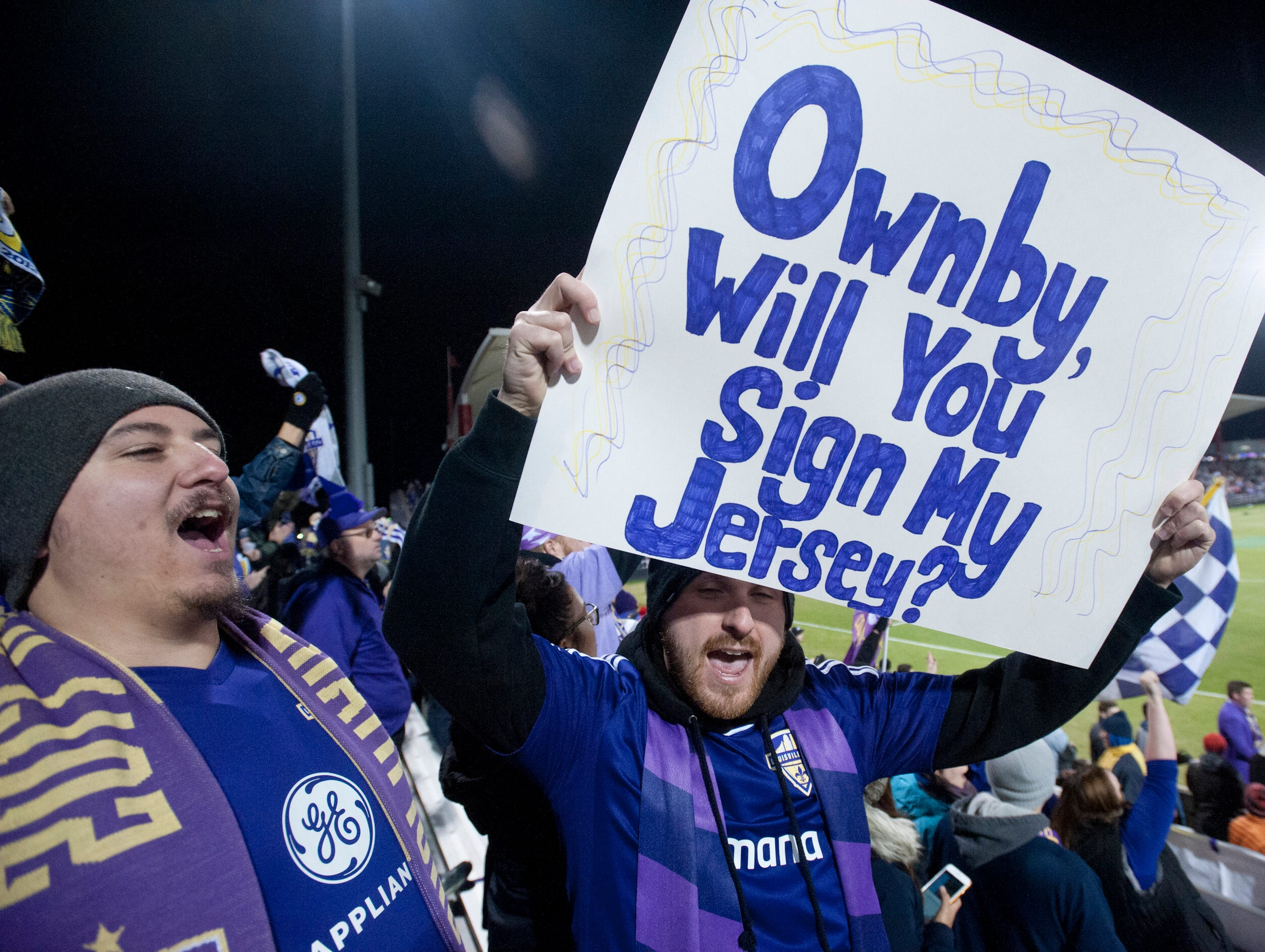 Austin Ali and Tyler Halbert of Jeffersonville's poster asks Louisville City FC player Brian Owenby to sign their jersey.November 08, 2018