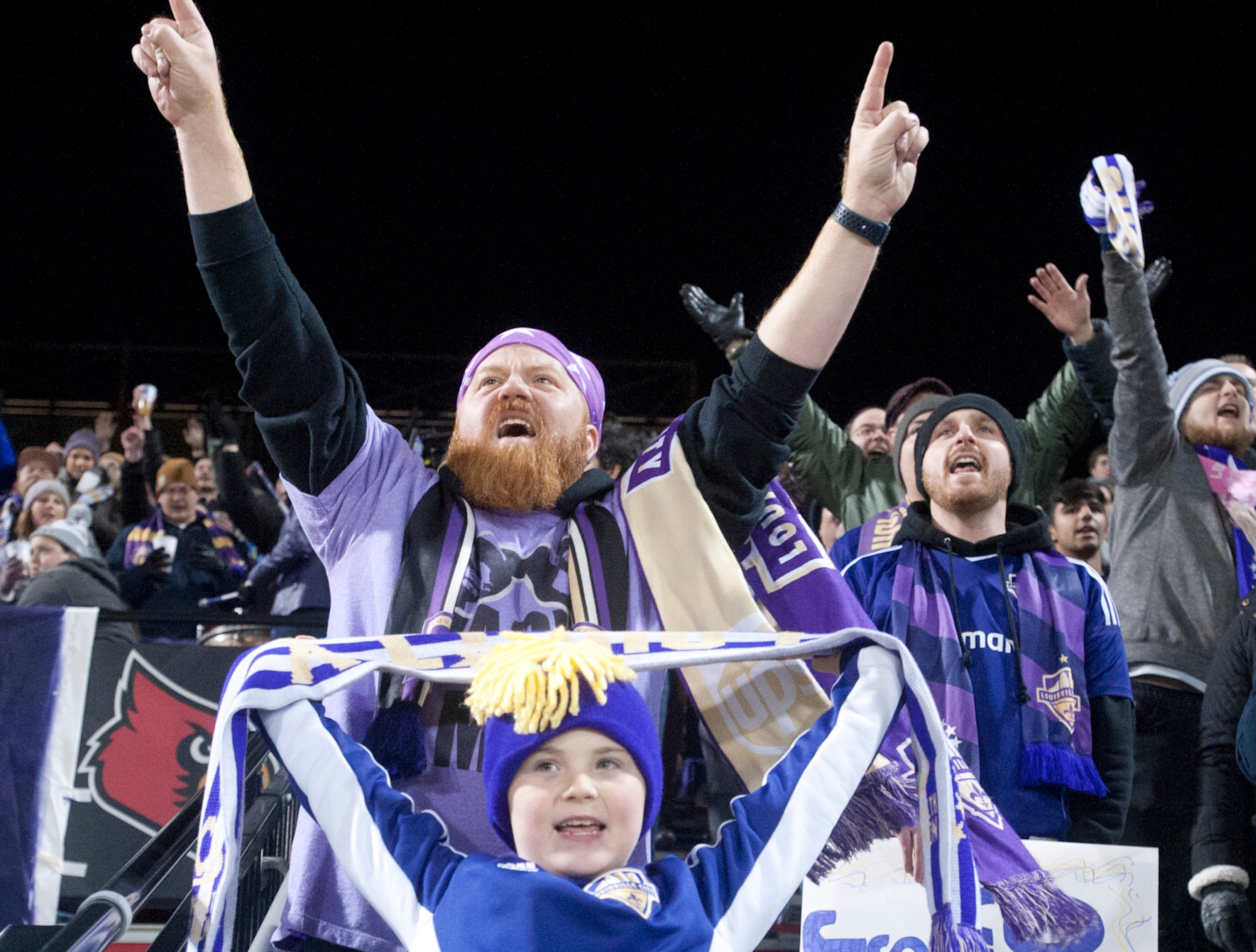 Chris Foreman and his son, Logan, age 7, root for Louisville City during the game.November 08, 2018