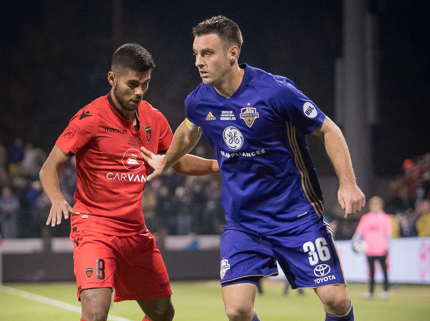 Phoenix Rising FC midfielder Collin Fernandez (8) plays against Louisville City FC midfielder Paolo DelPiccolo (36) during the USL Cup final played at Lynn Stadium on the campus of the University of Louisville, Louisville, Ky., Thursday, Nov., 8, 2018.
