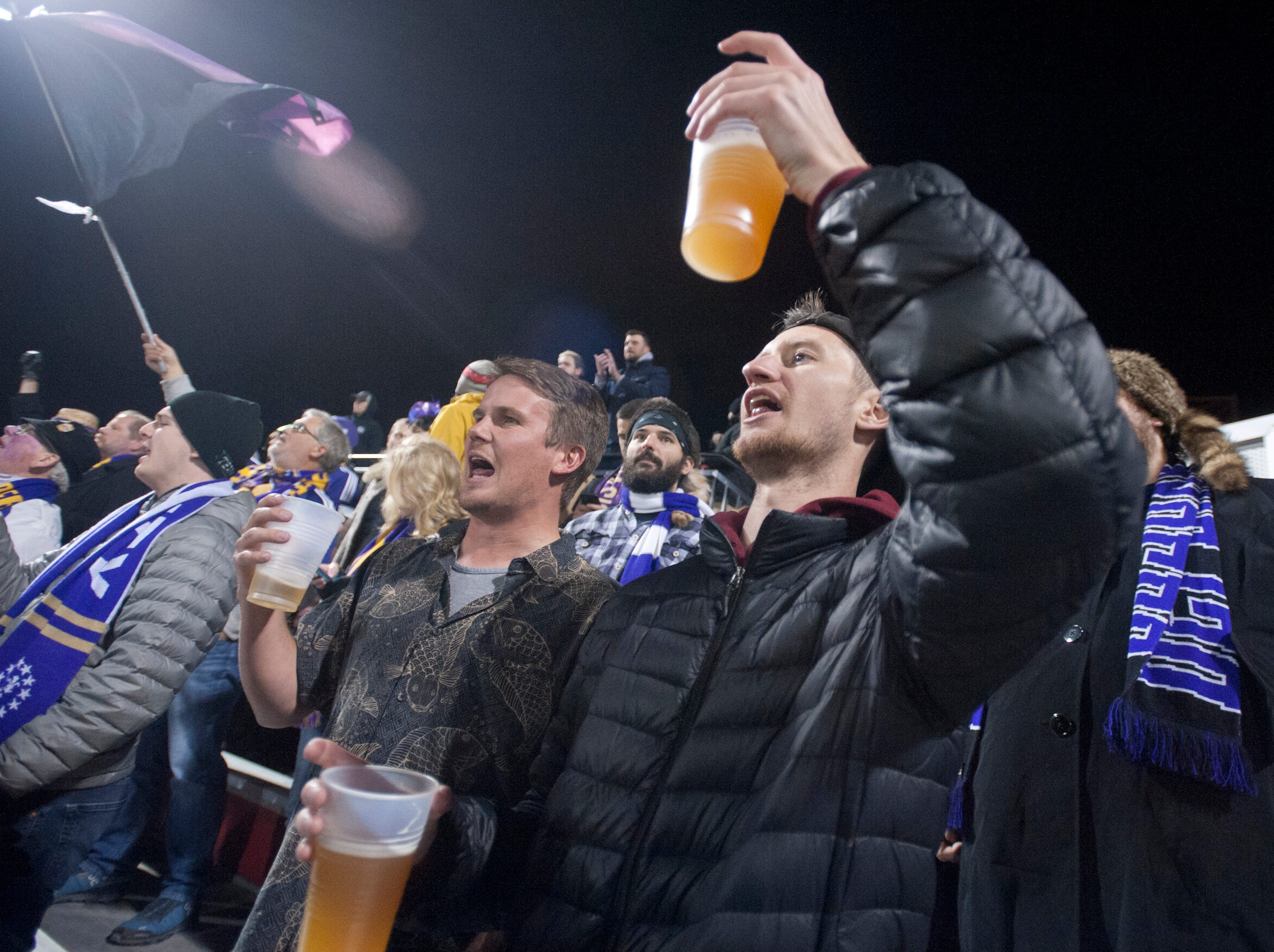 Kyle Barrett, left, and Matt Kabbes, right, of Shively, raise their beers in support of the Louisville City FC as it takes on the Phoenix Rising FC for the 2018 USL Cup.November 08, 2018
