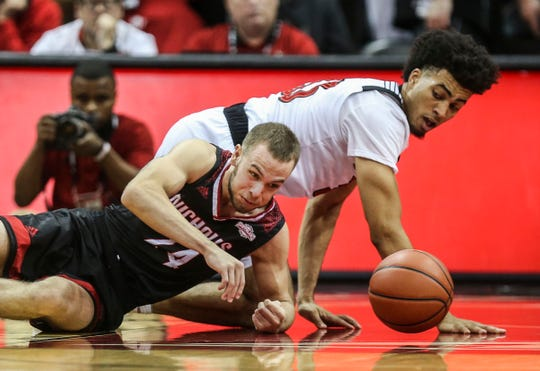 Louisville's Jordan Nwora scrambles for the loose ball with Nicholls State's Denny Garrick at the KFC Yum! Center Nov. 8, 2018. Nwora finished with 12 points .