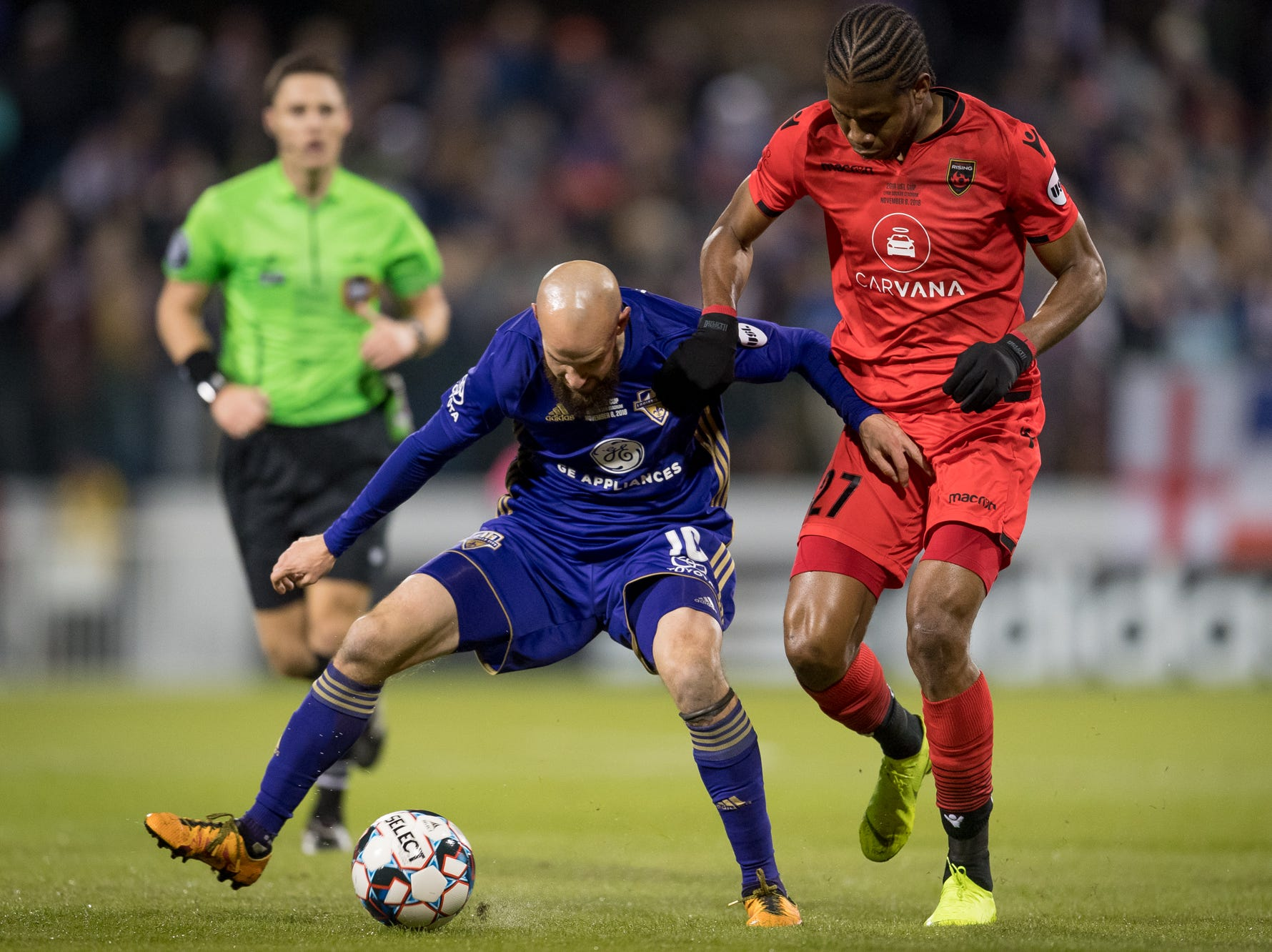 Louisville City FC midfielder Brian Ownby (10) plays against Phoenix Rising FC midfielder Kevon Lambert (27) during the first half of the USL Cup final played at Lynn Stadium on the campus of the University of Louisville, Louisville, Ky., Thursday, Nov., 8, 2018. (PHOTO Bryan Woolston)