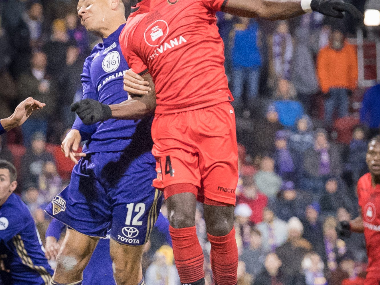 Louisville City FC forward Luke Spencer (12) collides with Phoenix Rising FC forward Jason Johnson (14) during the USL Cup final played at Lynn Stadium on the campus of the University of Louisville, Louisville, Ky., Thursday, Nov., 8, 2018.