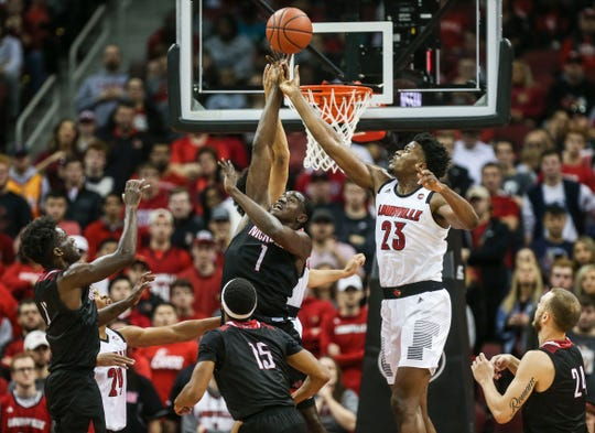"Louisville's Steven Enoch, right reaches for a rebound as Nicholls State's Daniel Regis battles in the season opener. ""We've got to get a lot better in a hurry, and hopefully tonight was a little dose of reality for our guys,"" said Louisville coach Chris Mack afterwards. Nov. 8, 2018."