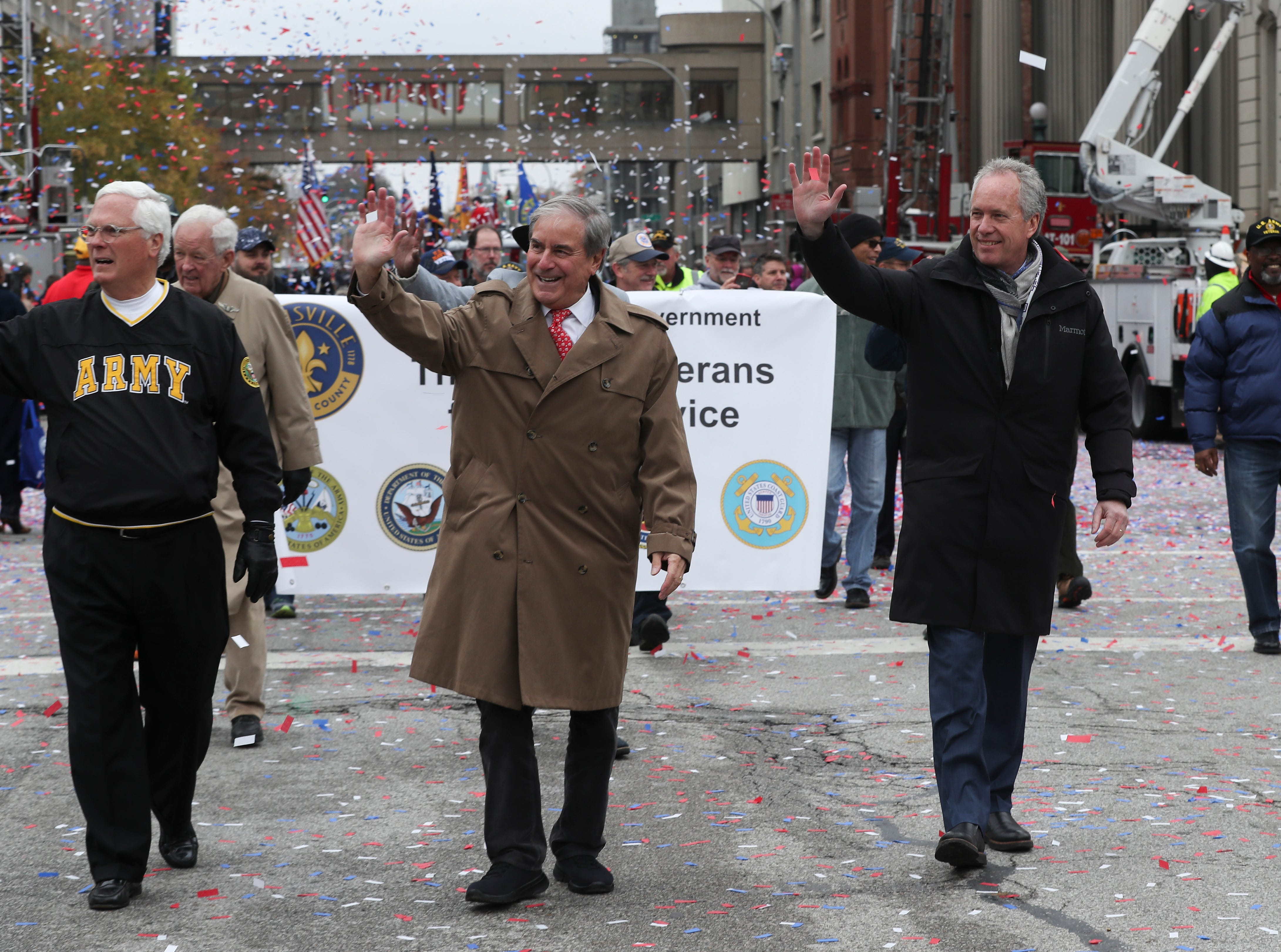Mayor Greg Fischer, right, and Congressman John Yarmuth marched down Jefferson Street during the Veterans Day Parade.  They both won their re-election bids this week.Nov. 9, 2018