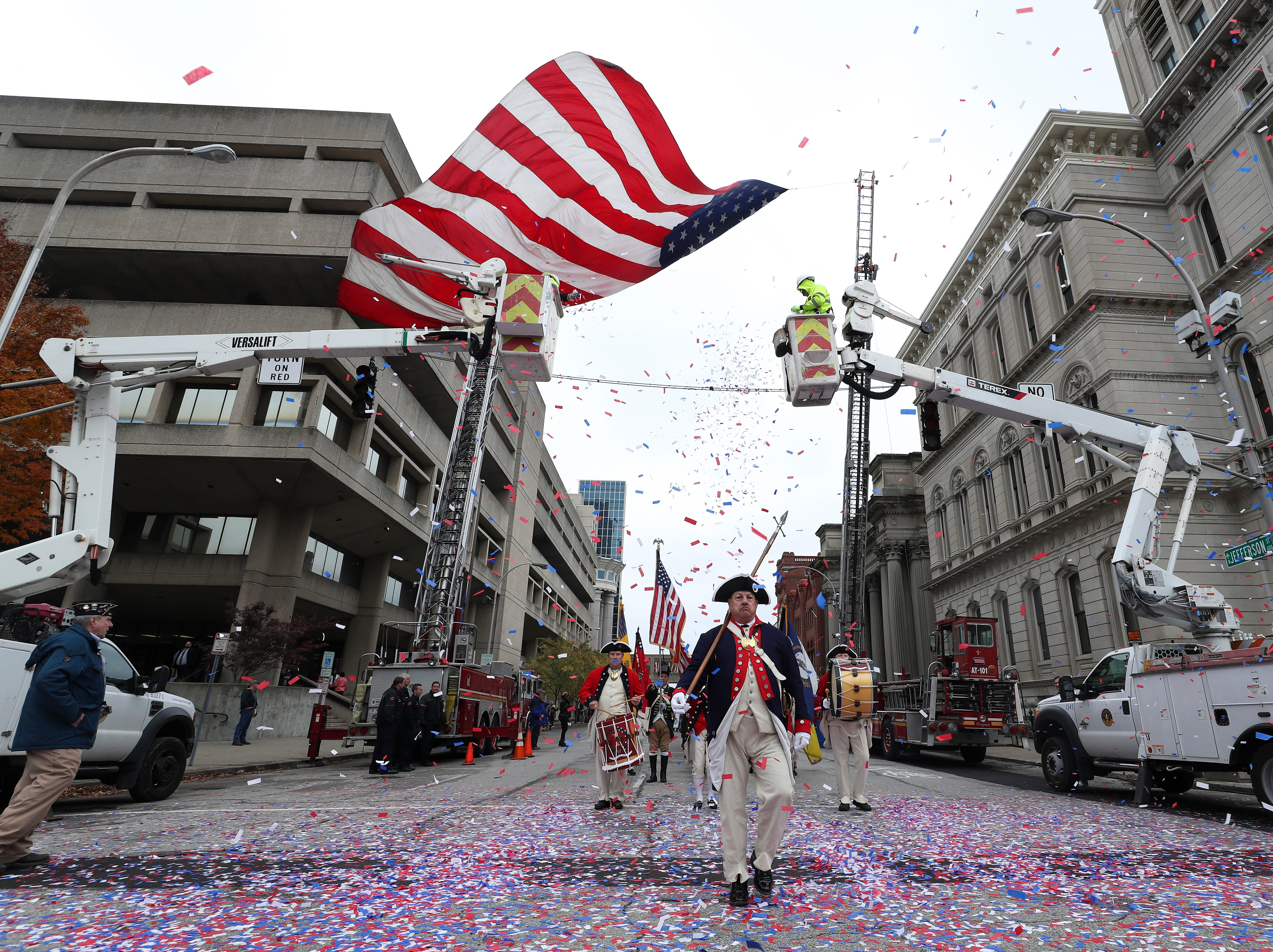 Louisville veterans 'carry the torch' for next generation at parade