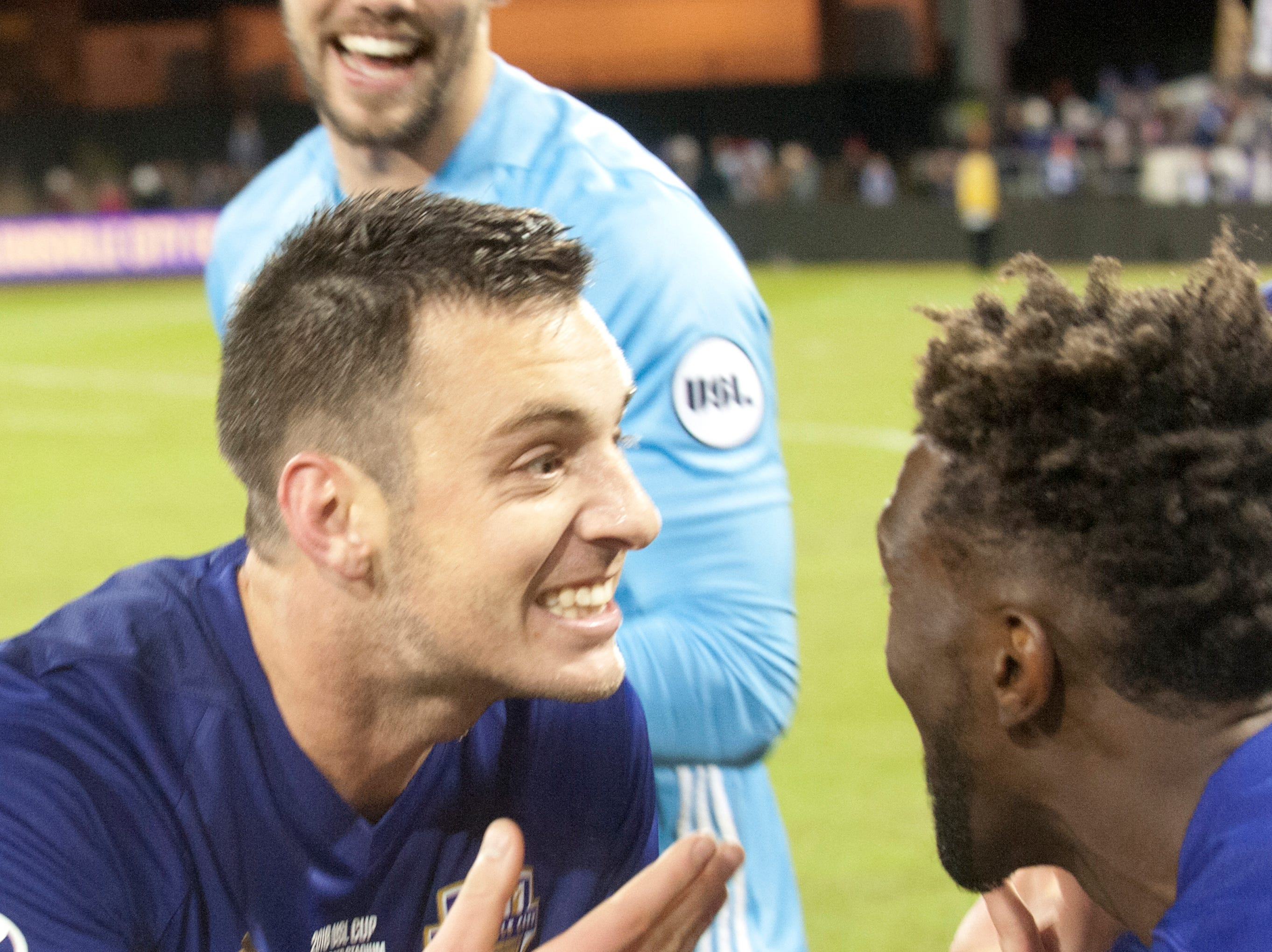 Louisville City midfielder Paolo Delpiccol celebrates his team's win over Phoenix Rising FC for the 2018 USL Cup with teammate Shaun Francis, right.November 08, 2018