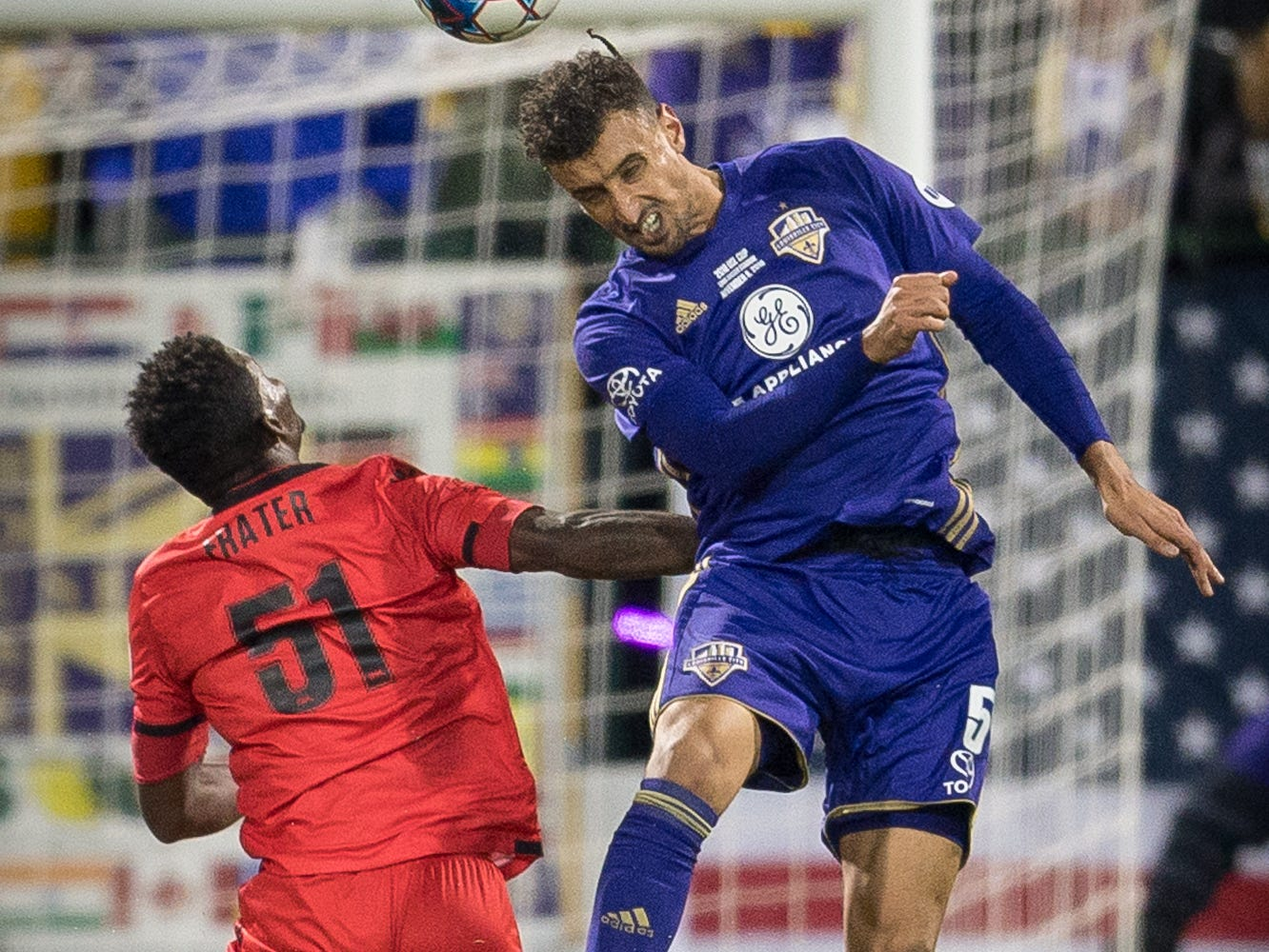 Louisville City FC defender Paco Craig (5) collides with Phoenix Rising FC forward Kevaughn Frater (51) during the first half of the USL Cup final played at Lynn Stadium on the campus of the University of Louisville, Louisville, Ky., Thursday, Nov., 8, 2018. (PHOTO Bryan Woolston)