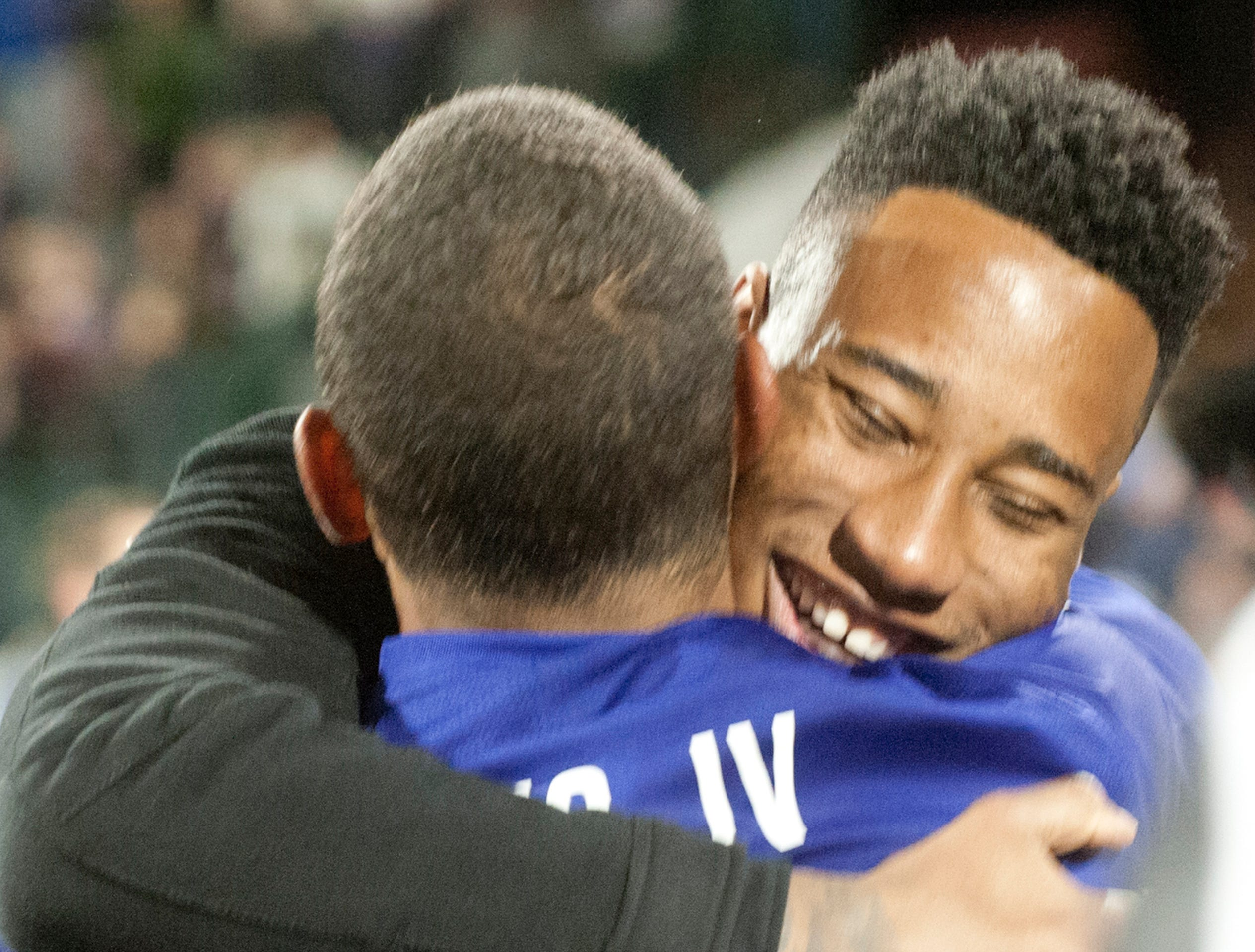 Former Louisville City FC player Mark-Anthony Kaye who now plays for the Los Angeles FC hugs his former teammate, Louisville City midfielder George Davis IV, after Louisville defeated the Phoenix Rising FC to capture the 2018 USL Cup.November 08, 2018