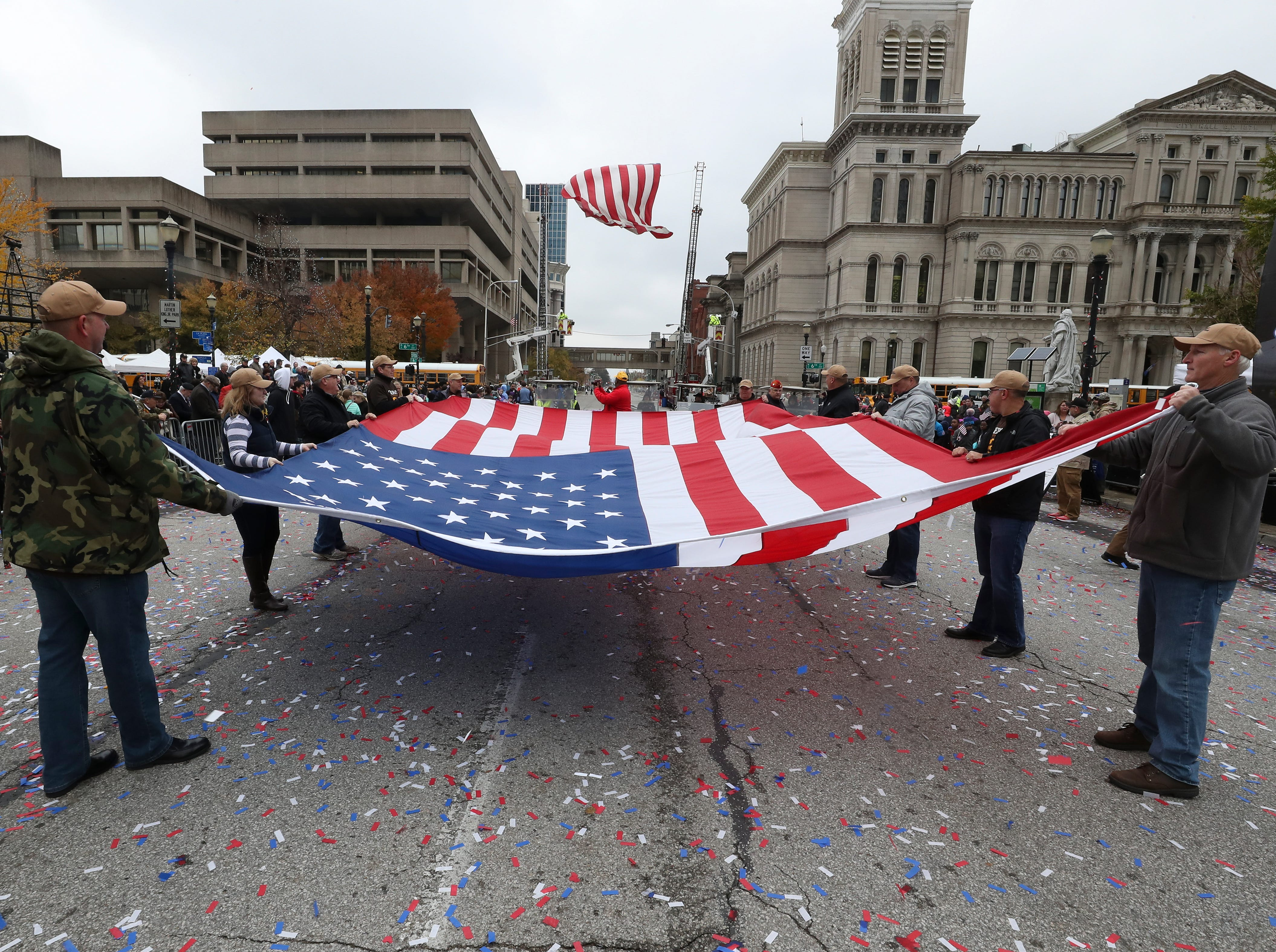 A U.S. flag was folded at the conclusion of the Veterans Day Parade on Jefferson Street.Nov. 9, 2018