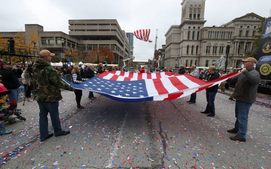 A U.S. flag was folded at the conclusion of the Veterans Day Parade on Jefferson Street.