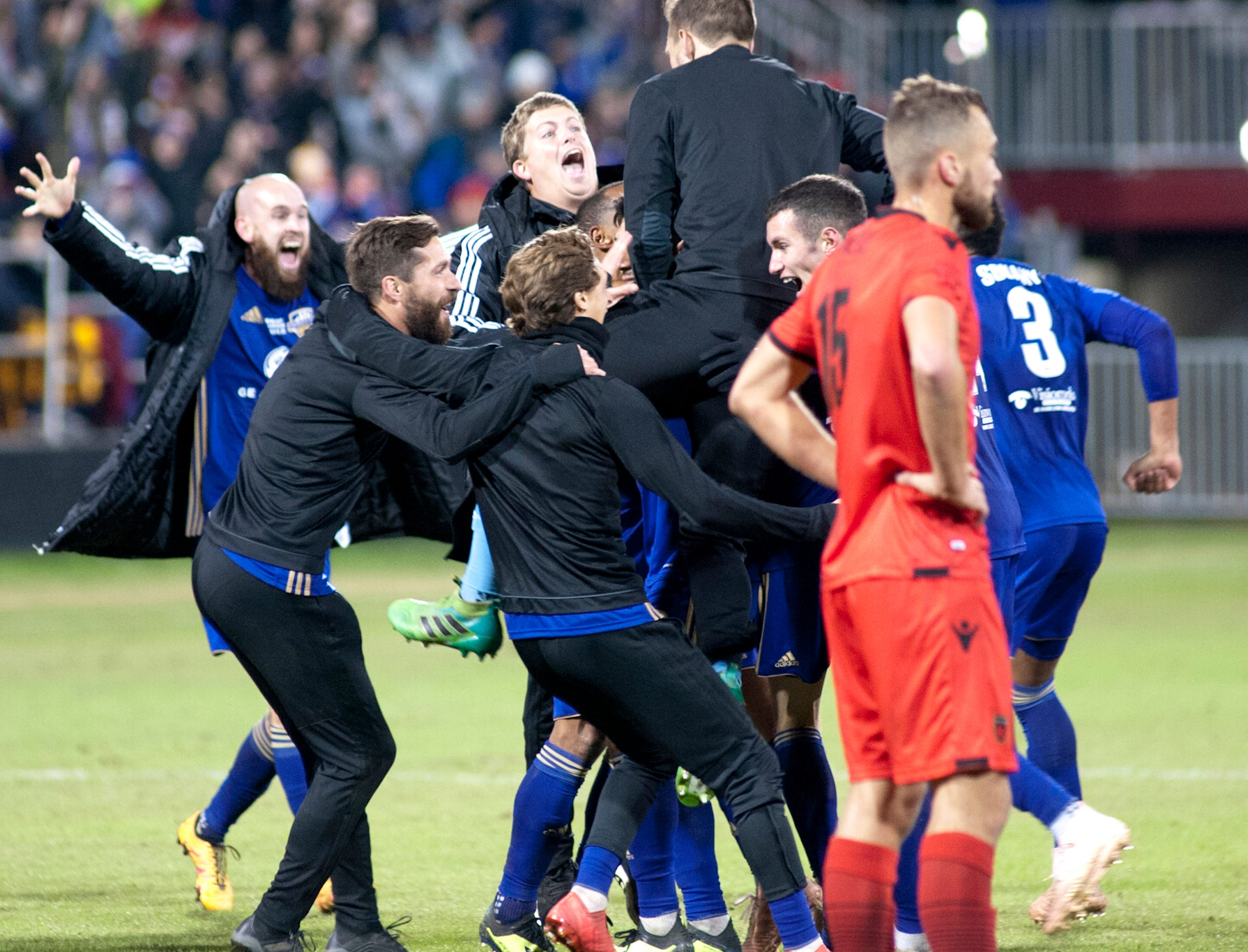 Phoenix Rising FC defender Joseph Farrell reacts to his team's loss as as Louisville City FC celebrates their 1-0 victory in the 2018 USL Cup.November 08, 2018