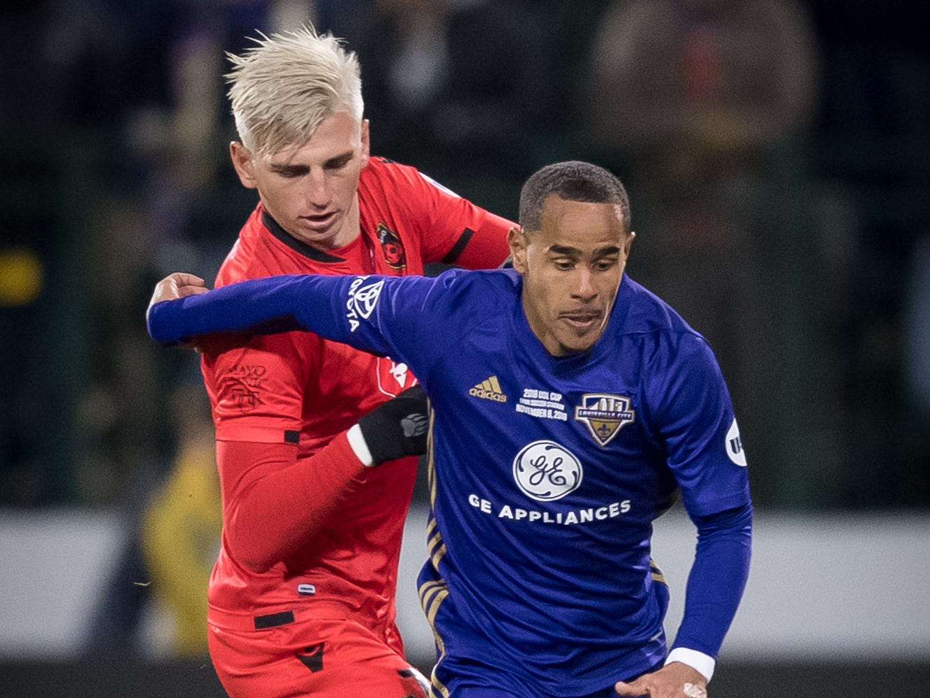 Louisville City FC midfielder George Davis IV (22) plays against Phoenix Rising FC defender Tristian Blackman (77) during the USL Cup final played at Lynn Stadium on the campus of the University of Louisville, Louisville, Ky., Thursday, Nov., 8, 2018.