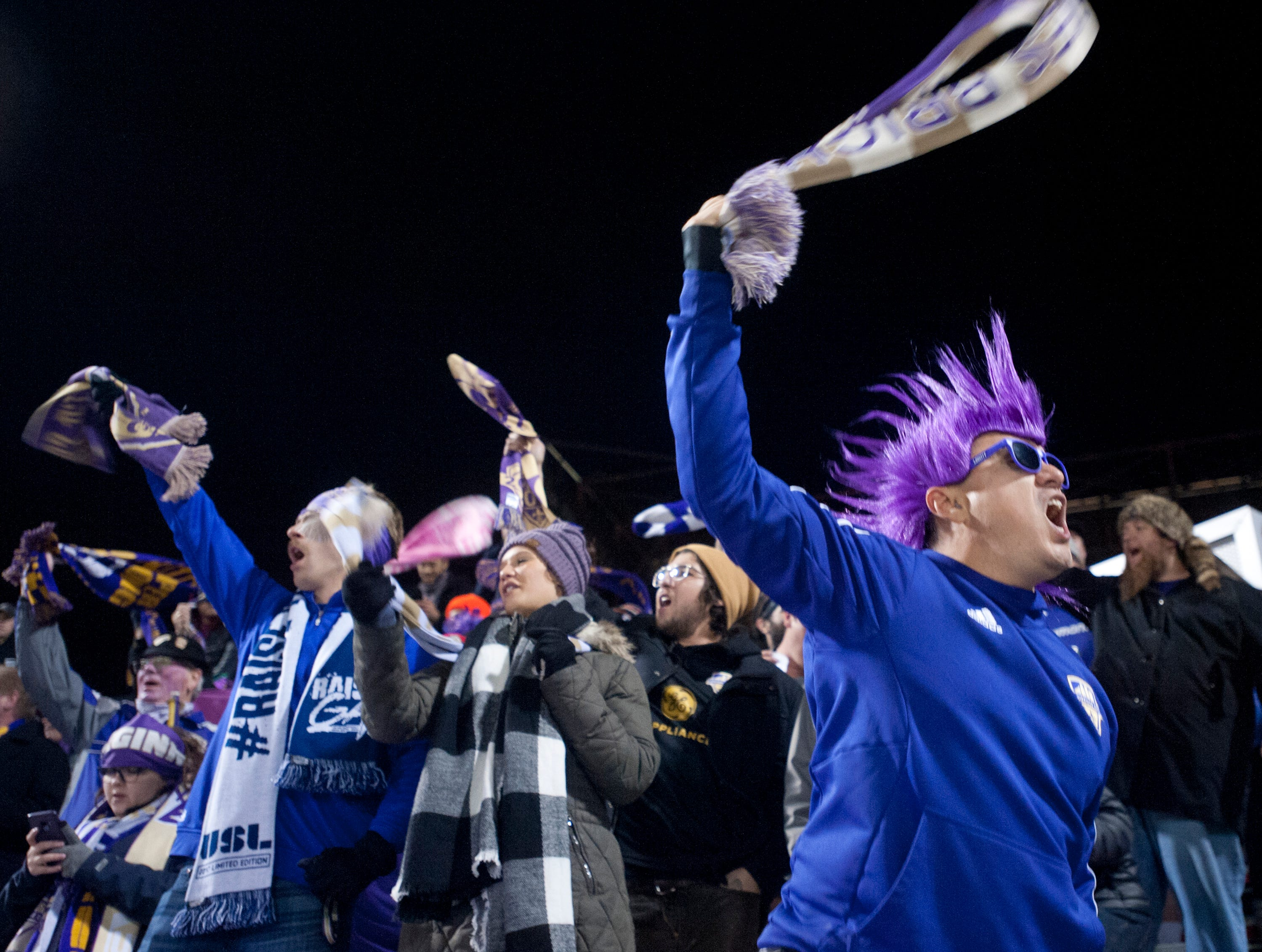 Jorge Pazmino of Bullitt Co., Ky., twirls a towel around his head as he roots for the home team as Louisville City FC takes on the Phoenix Rising FC for the 2018 USL Cup.November 08, 2018