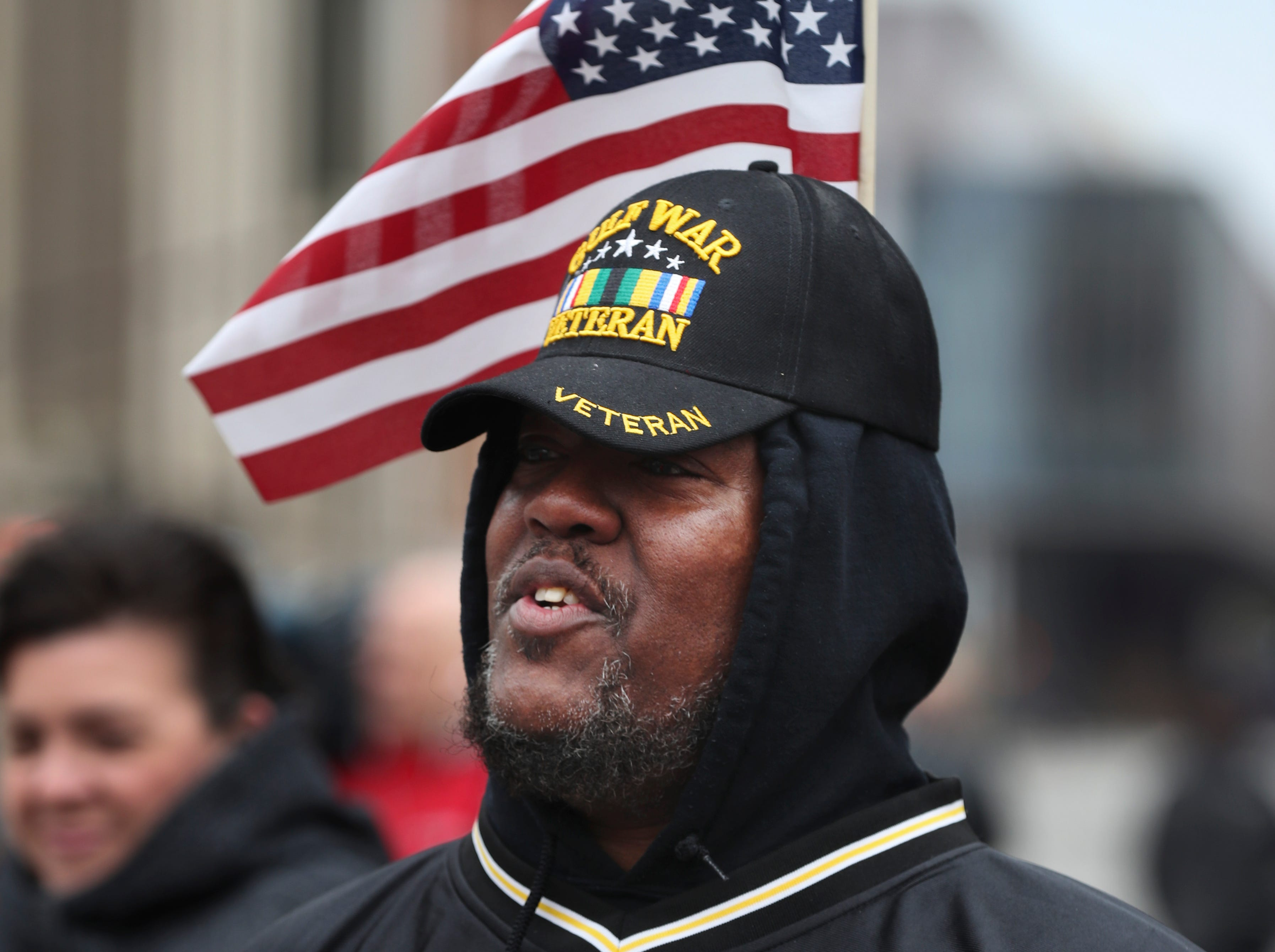 Sgt. Tim West, Ret. Army, watched the Veterans Day Parade march down Jefferson Street.Nov. 9, 2018