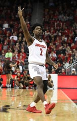 Louisville's Darius Perry (2) celebrated a score against Nicholls State during their game at the Yum Center.   Nov. 8, 2018