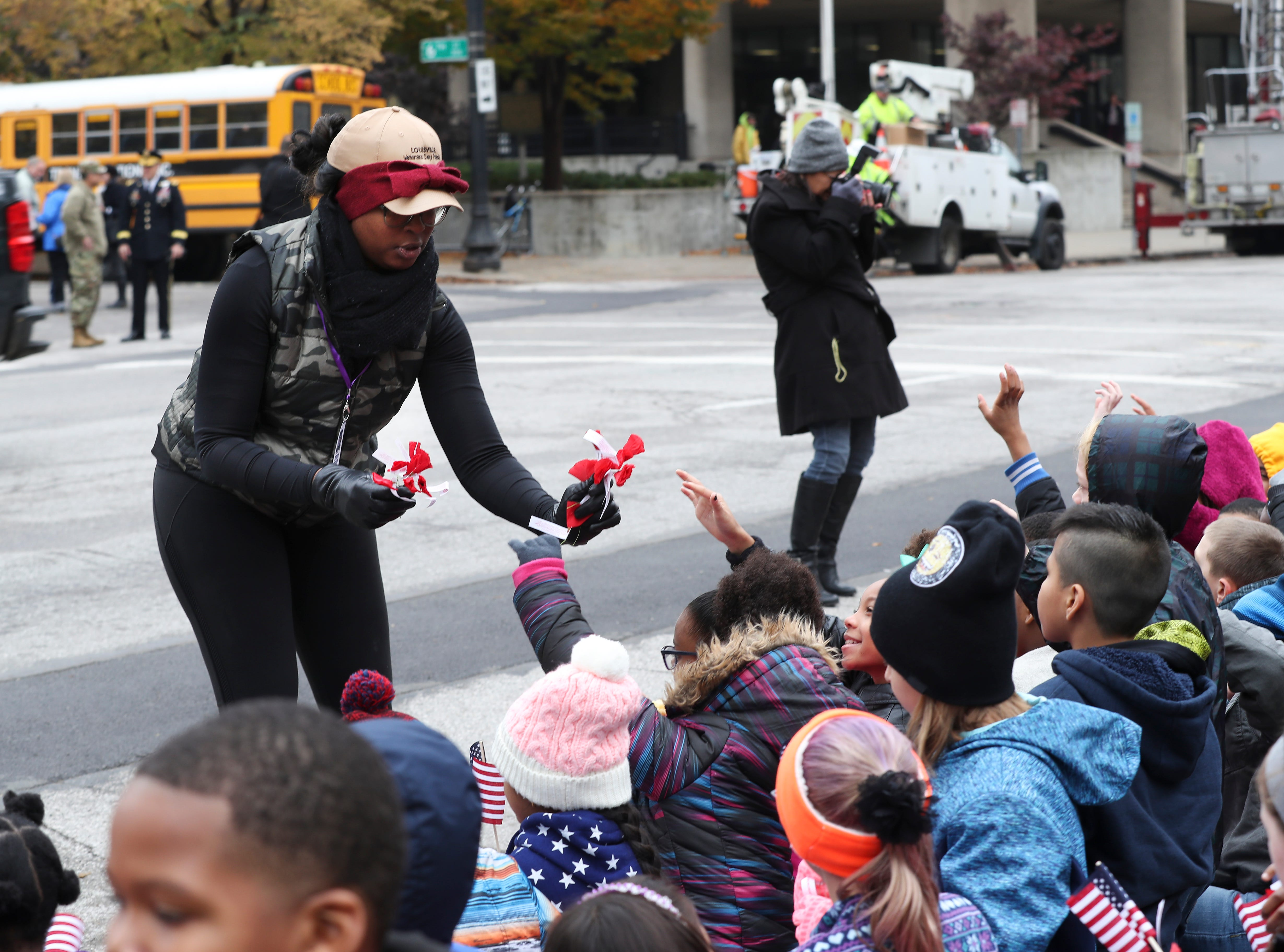 Shia Daniel handed out Poppy flowers, a symbol of peace, during the Veterans Day Parade on Jefferson Street.  Nov. 9, 2018