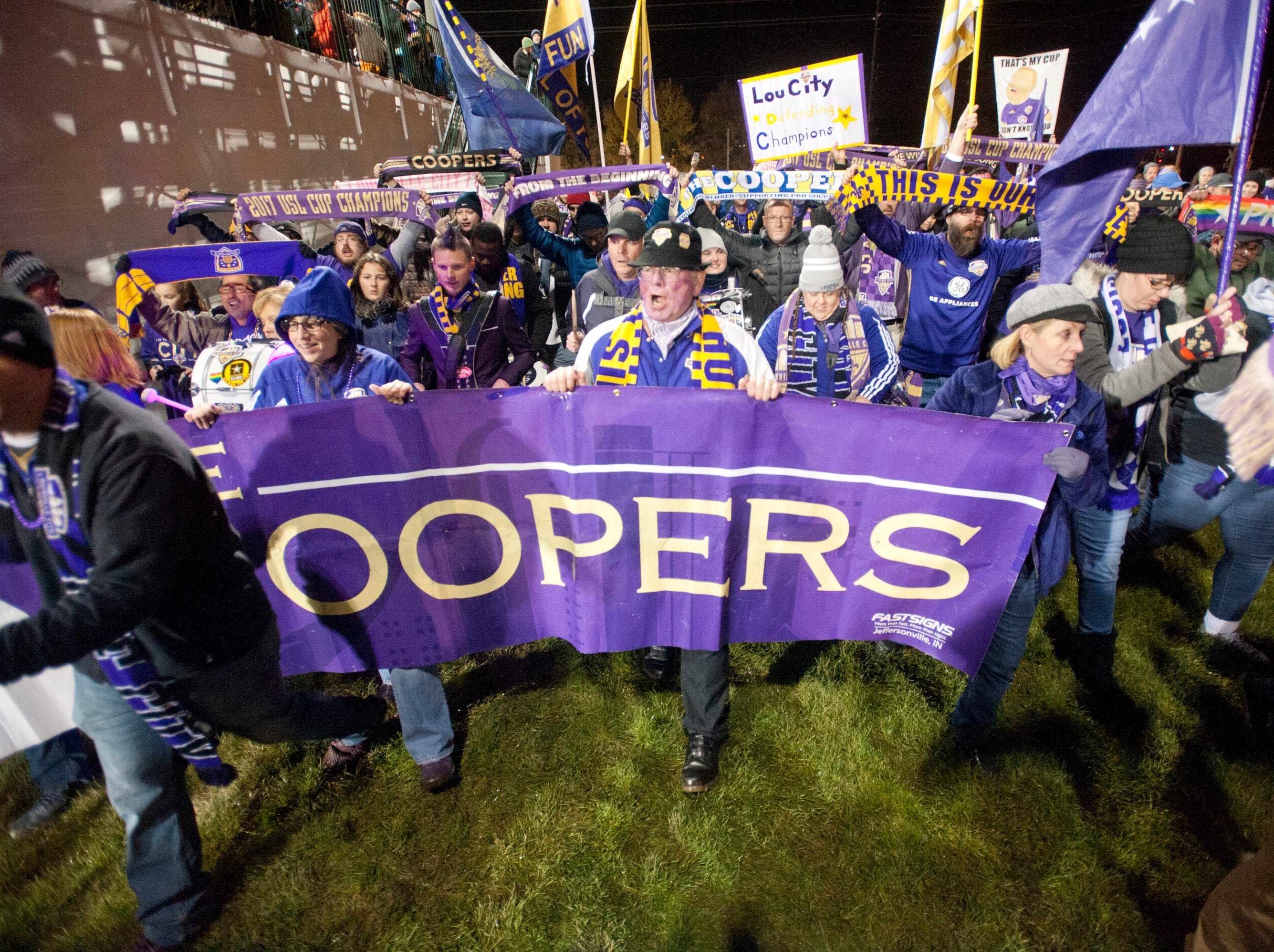 John Roca, center, joins other Louisville Coopers fans as they march into the stadium to support their team, Louisville City.November 08, 2018