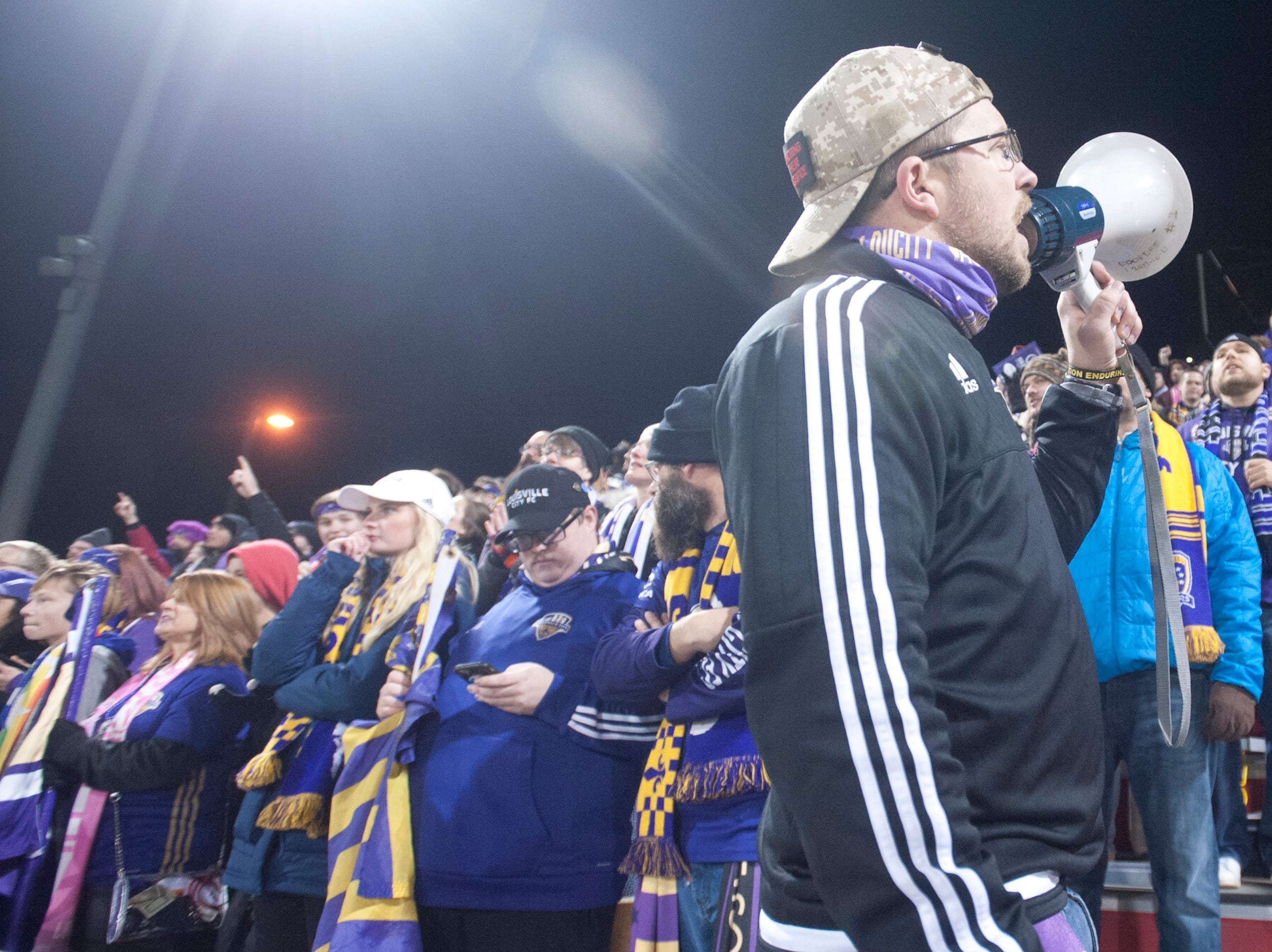 Alex Miner, vice president of the Louisville Coopers fan club works the megaphone as Louisville City FC takes on the Phoenix Rising FC for the 2018 USL Cup.November 08, 2018