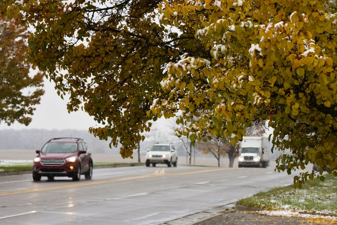 A light dusting of snow can be seen on Collins Road in Lansing in this 2018 file photo.