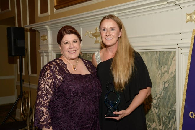 Lyn Donaldson Zynda, left, presented Dr. Christine Perry with the Janet M. Wendorf Outstanding Caregiver Award at McLaren Greater Lansing Foundation's Annual Gala at the Country Club of Lansing on October 13.