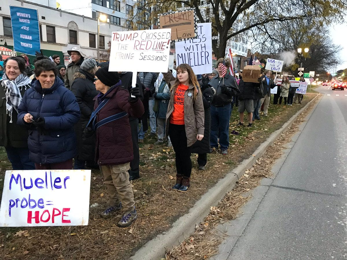 A crowd in East Lansing estimated Thursday night to be at least 200 people showed they oppose President Donald Trump's decision to fire Jeff Sessions. Protesters said they worry the former attorney general's absence will mean an end of the Mueller investigation.