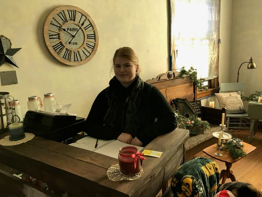 Sabrina Krejci sits behind a counter inside Dylan's Den where she will have her own business. The 19-year-old Neillsville girl has overcome many health-related issues to start the business with community support.