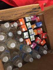 Organizers brought a box of drinks to pass out to central American migrants at the Memphis Greyhound station.