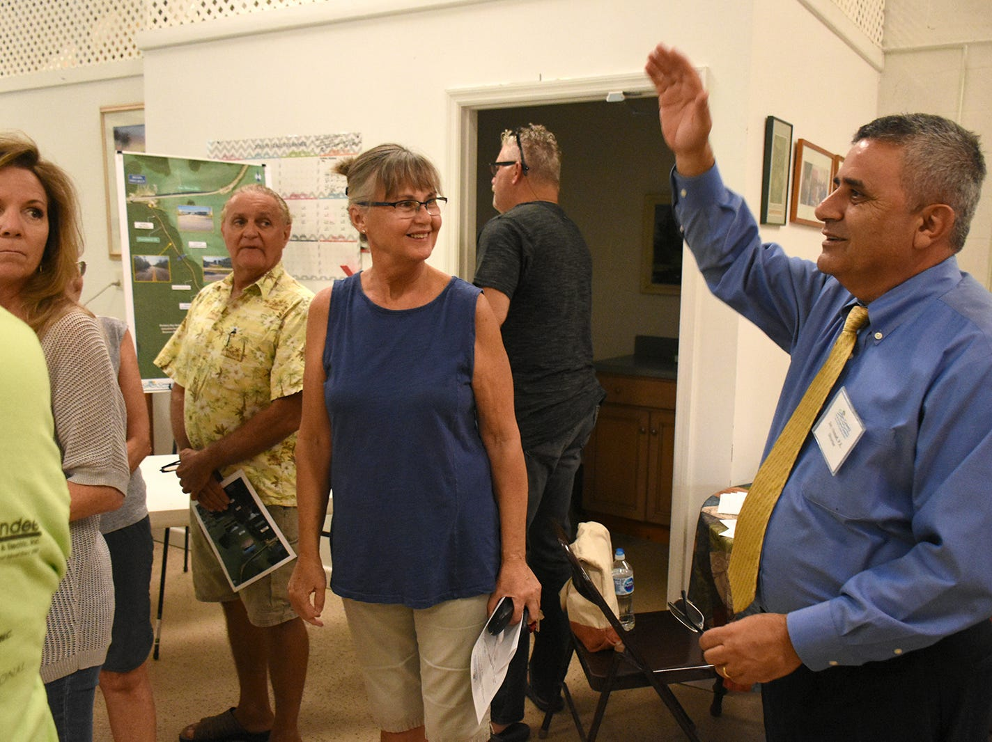 Department director Jay Ahmad answers a resident's question. County planners held a public information meeting at the Goodland Community Center on Thursday evening, to go over plans and solicit resident input on the upcoming work to improve Goodland Drive.