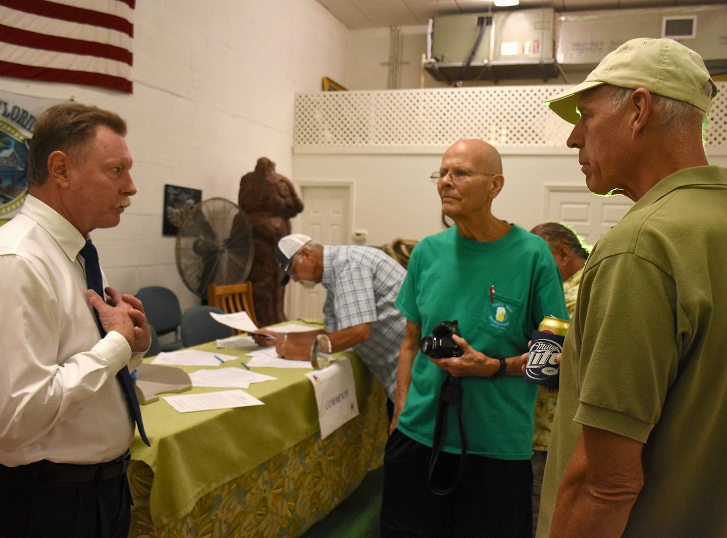 Project manager Andy Miller, left, speaks with residents John Ritchie and Jim Seegers. County planners held a public information meeting at the Goodland Community Center on Thursday evening, to go over plans and solicit resident input on the upcoming work to improve Goodland Drive.