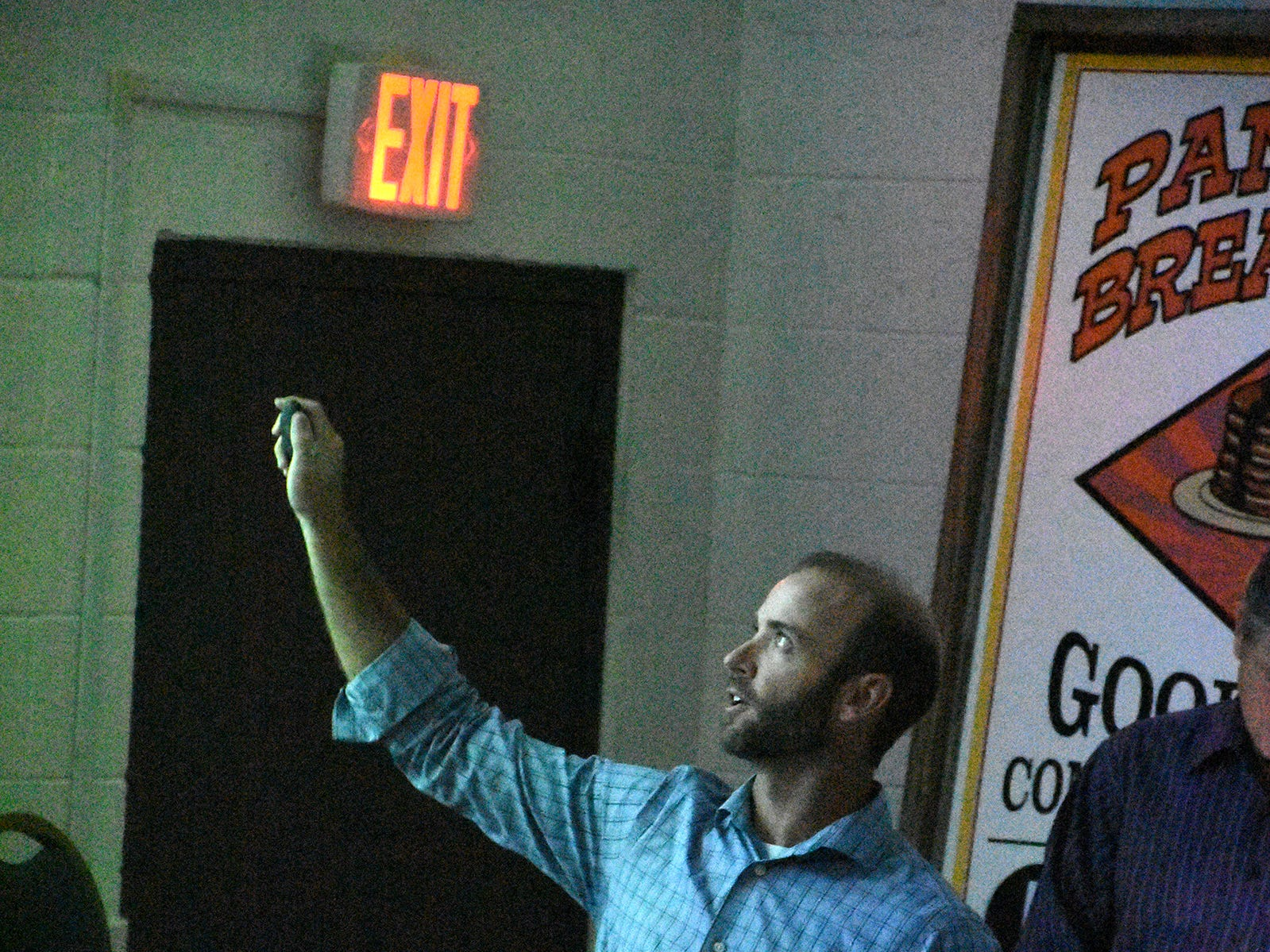 Consultant Daniel Flynn gives a slide presentation on the roadwork. County planners held a public information meeting at the Goodland Community Center on Thursday evening, to go over plans and solicit resident input on the upcoming work to improve Goodland Drive.