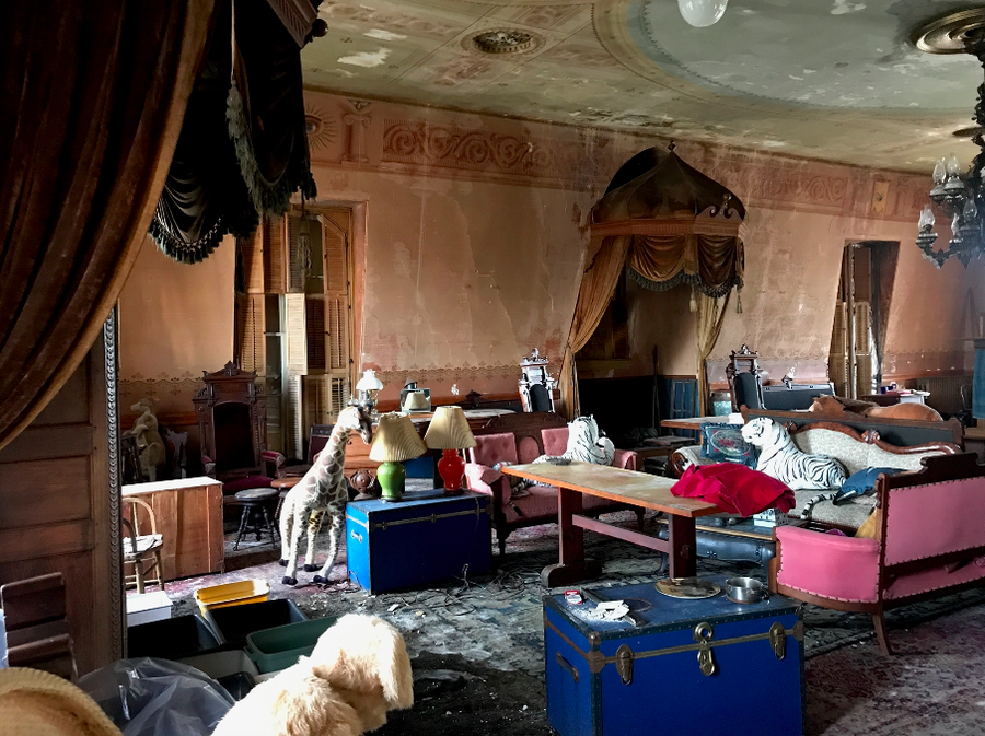 The top floor of Star of Hope, Robert Indiana's former home and studio. The historical hall dominates the small Main Street on Vinalhaven and is crumbling and leaking.