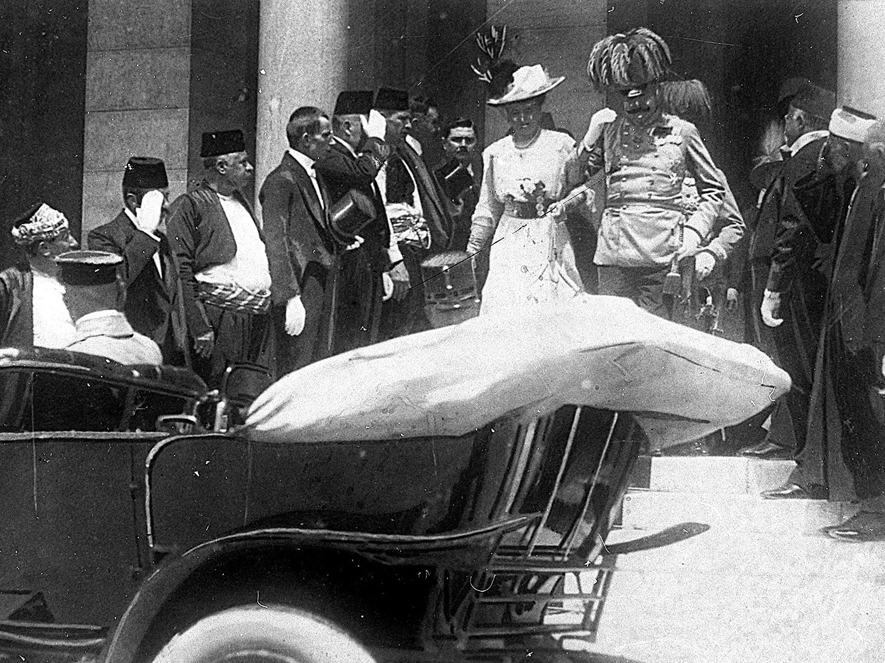 In this June 28, 1914, file photo, the Archduke of Austria Franz Ferdinand, center right, and his wife Sophie, center left, walk to their a car in Sarajevo, Yugoslavia. This photo was taken minutes before the assassination of Ferdinand and his wife,  which set off a chain of events that would eventually lead to World War I.