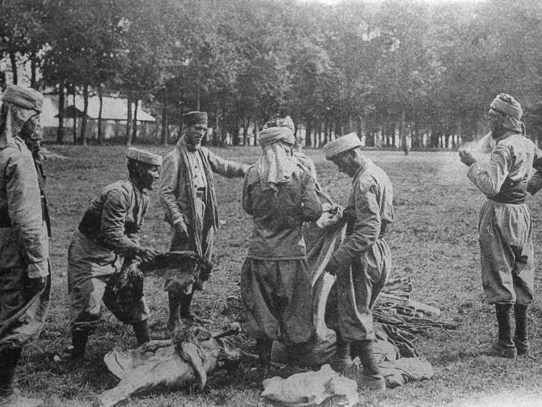 A file photo taken in 1914 shows a postcard released by the Historial de Peronne (WWI Museum) of a meat distribution in France to Algerian soldiers from the French colonies during WWI.