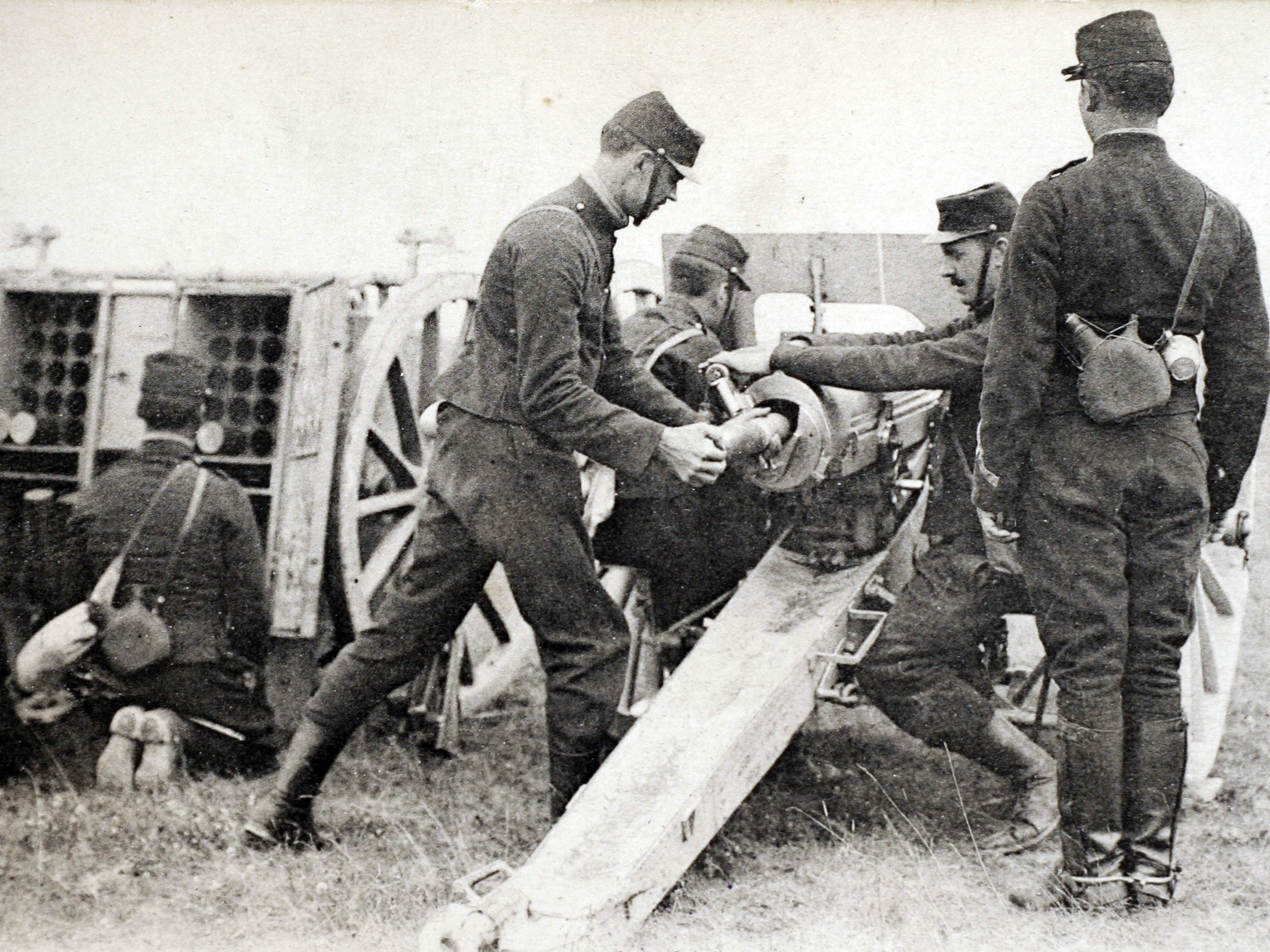 A picture of a post card released by the Historial de Peronne Museum of WWI, shows French artillery soldiers with a 75mm cannon in 1914 during World War I.