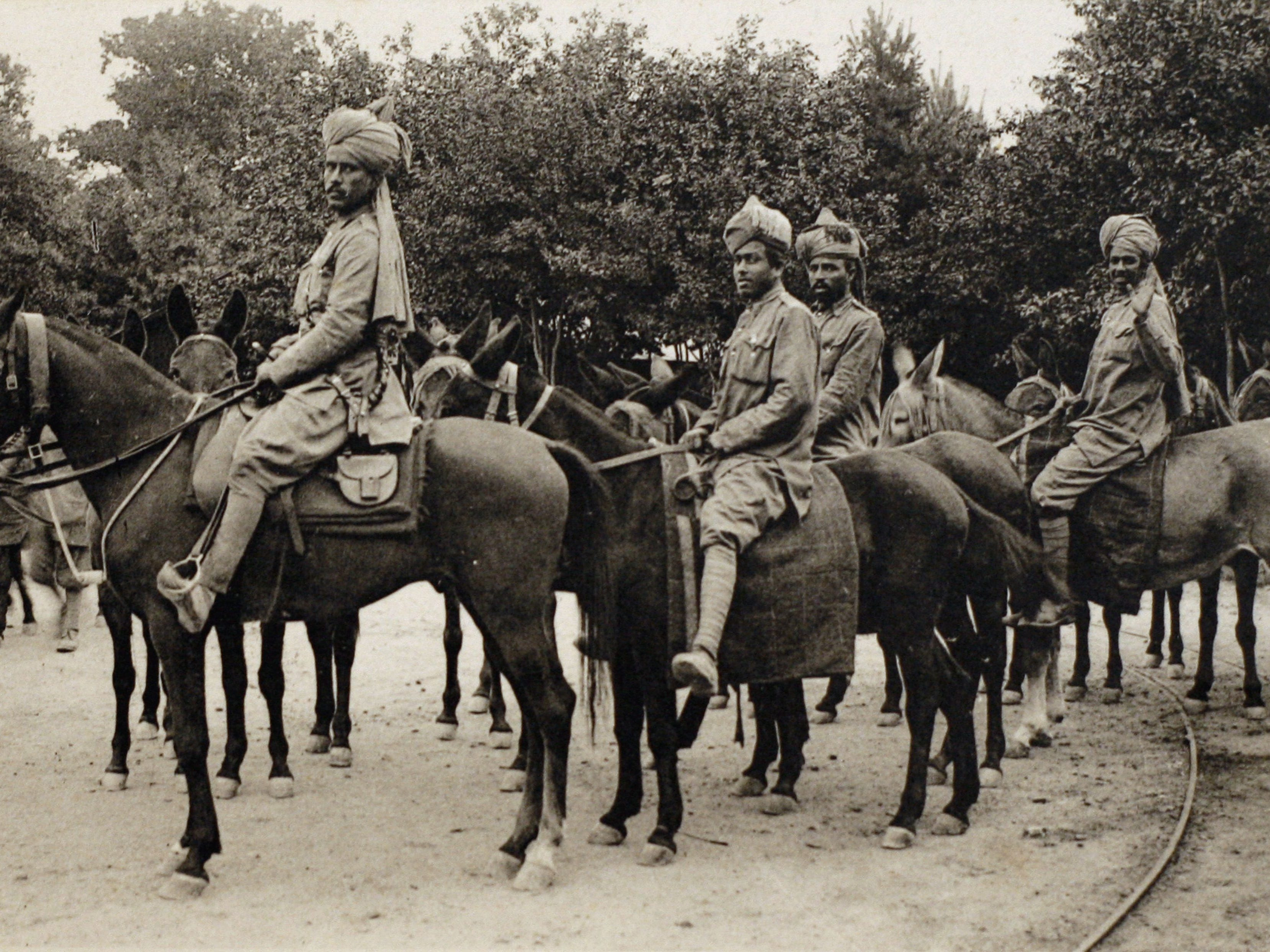 A photo taken in 1914 shows a postcard released by the Historial de Peronne (WWI Museum) of Indian cavalry troops from the British colonies in France.