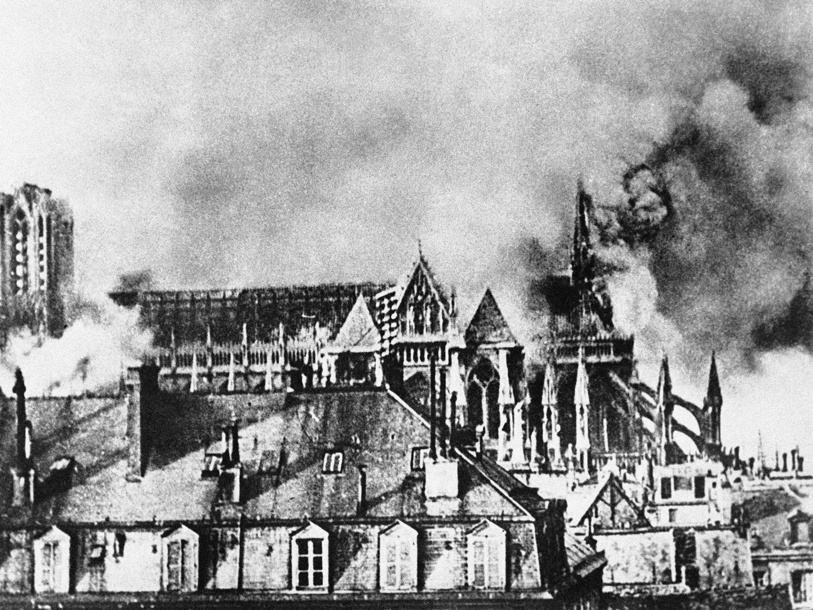 In this September 1914 file photo, the Cathedral of Reims, France, smokes after bombardment during World War I. The advancing German army heavily damaged the city.