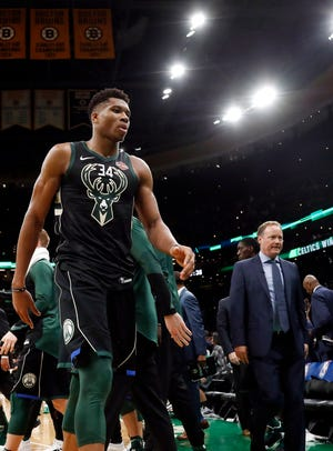Under the guidance of first-year coach Mike Budenholzer (right), Giannis Antetokounmpo and the Bucks are drawing favorable comparisons the 2014-'15 Golden State squad that took a giant leap during Steve Kerr's first year in charge of the Warriors.