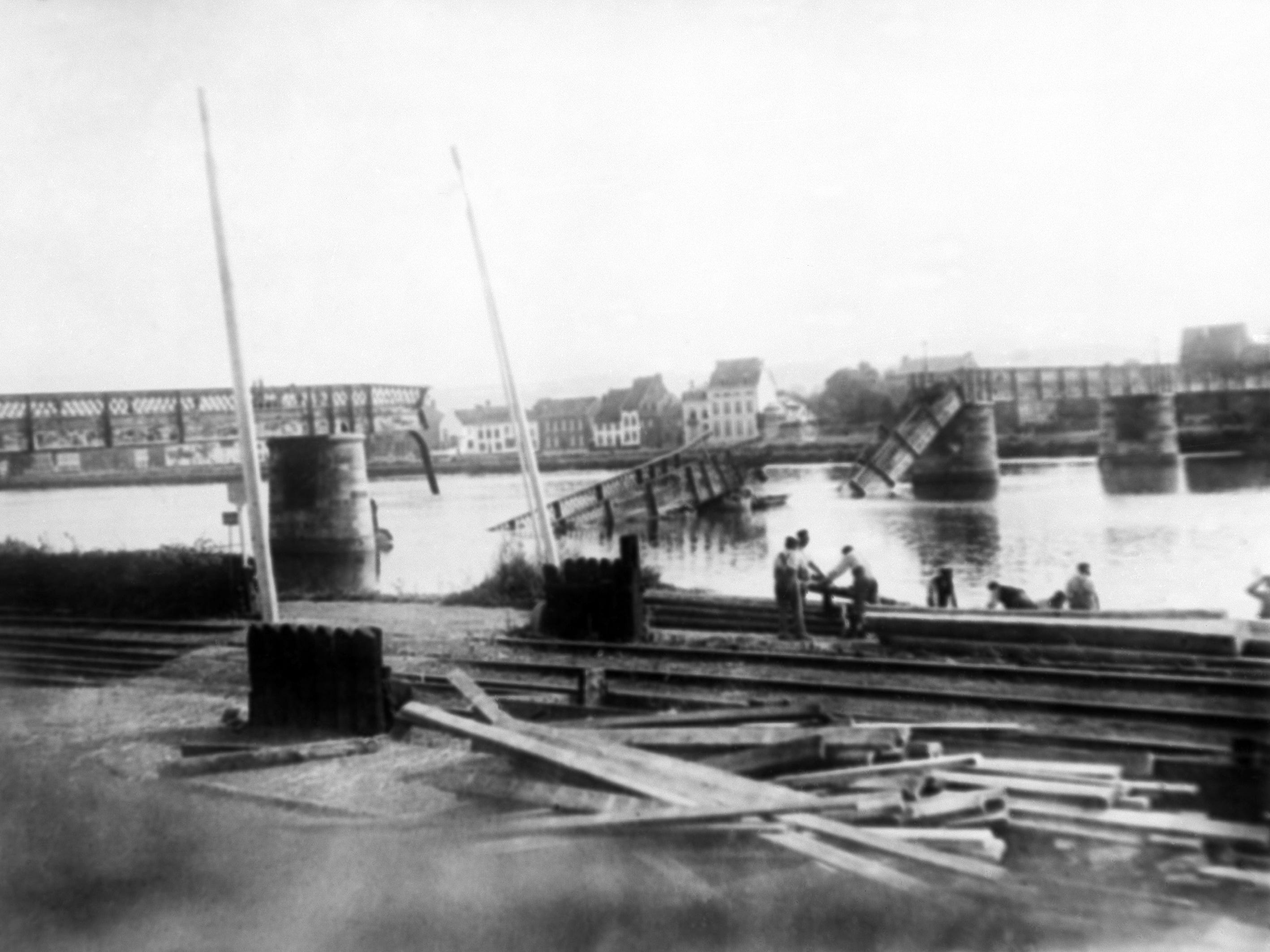 In this 1914 photo, a bridge across the Meuse River in Belgium, which was destroyed by retreating Belgian troops, is being rebuilt by invading German troops.
