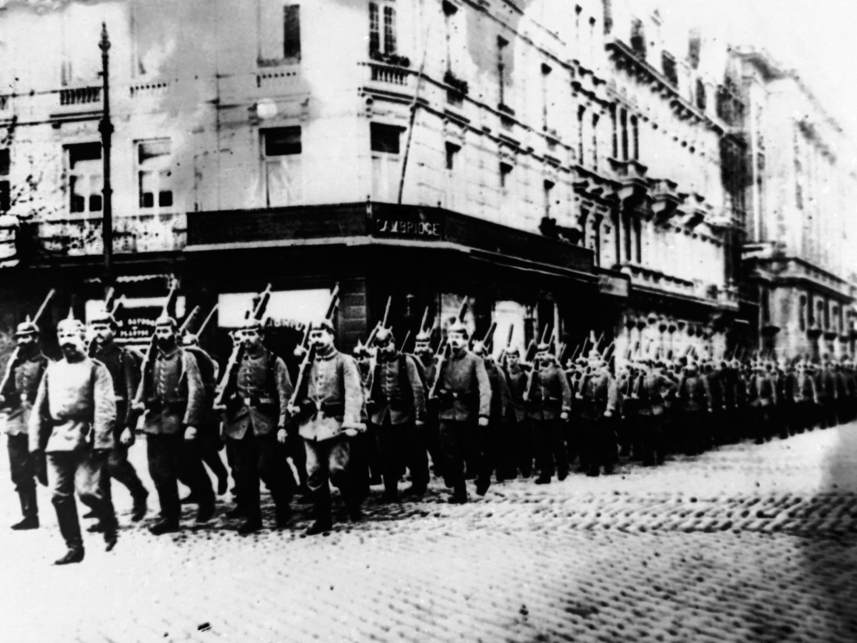 In this 1914 photo, German troops march through the streets of Antwerp, Belgium, during World War I.