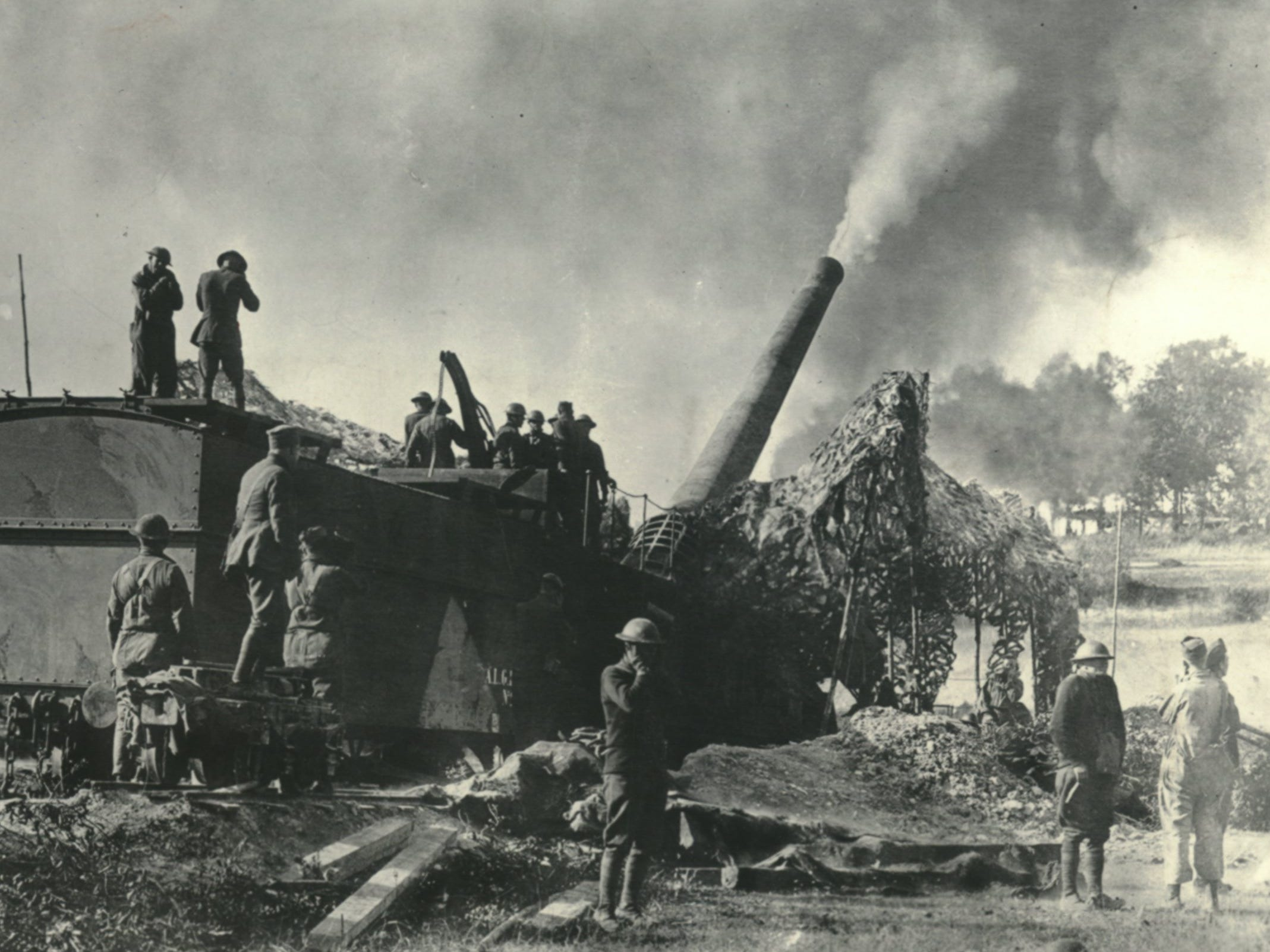 "In a U. S. WW I battle scene, a 13.9 inch railway gun is fired at Baleycourt while soldiers try to ""cover up"" from the noise and vibrations."